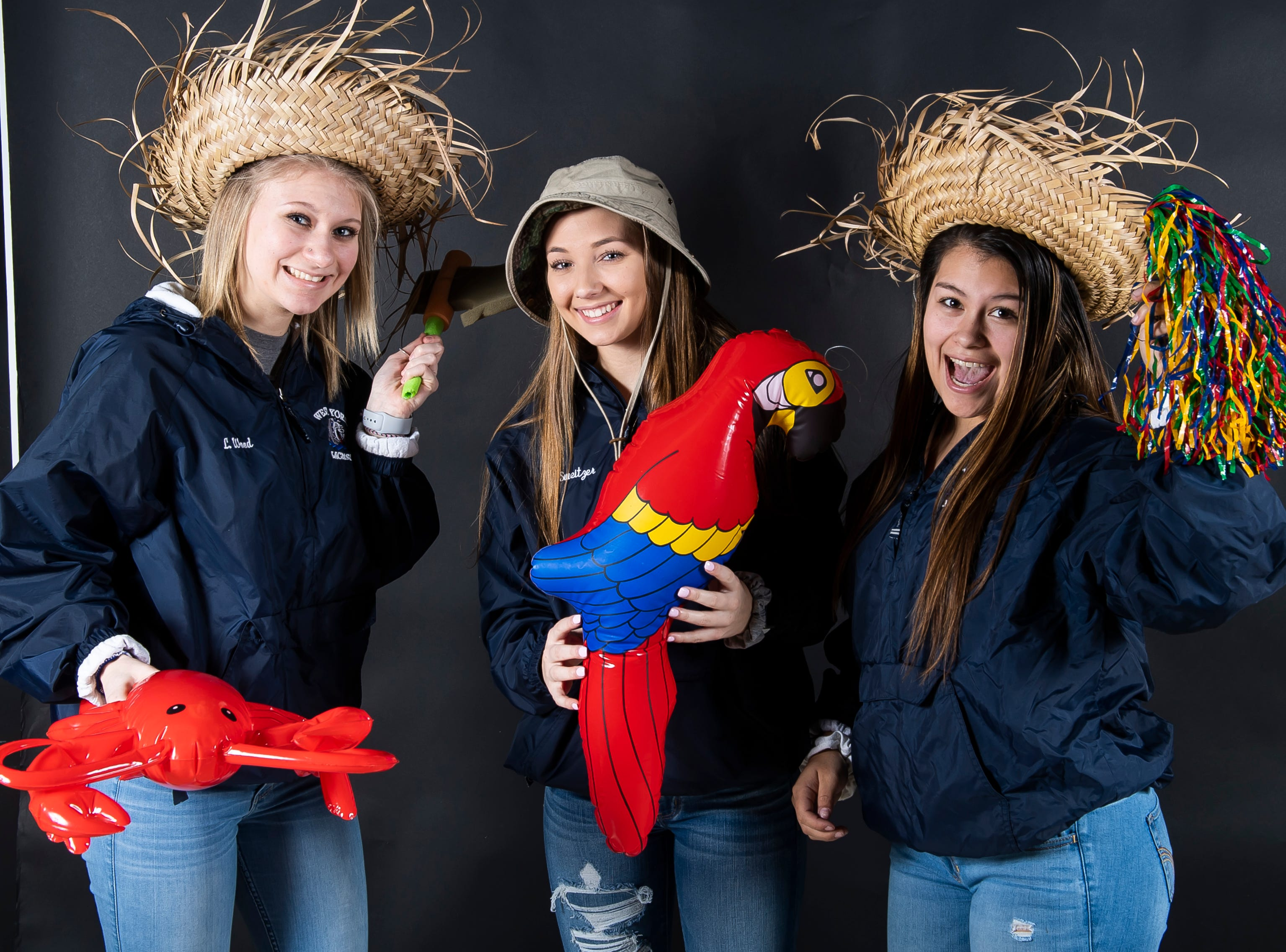 (From left) West York lacrosse players Lizzie Wood, Sydney Sweitzer and Libby Bahoric strike a pose in the GameTimePA photo booth during spring sports media day in York Sunday, March 10, 2019.