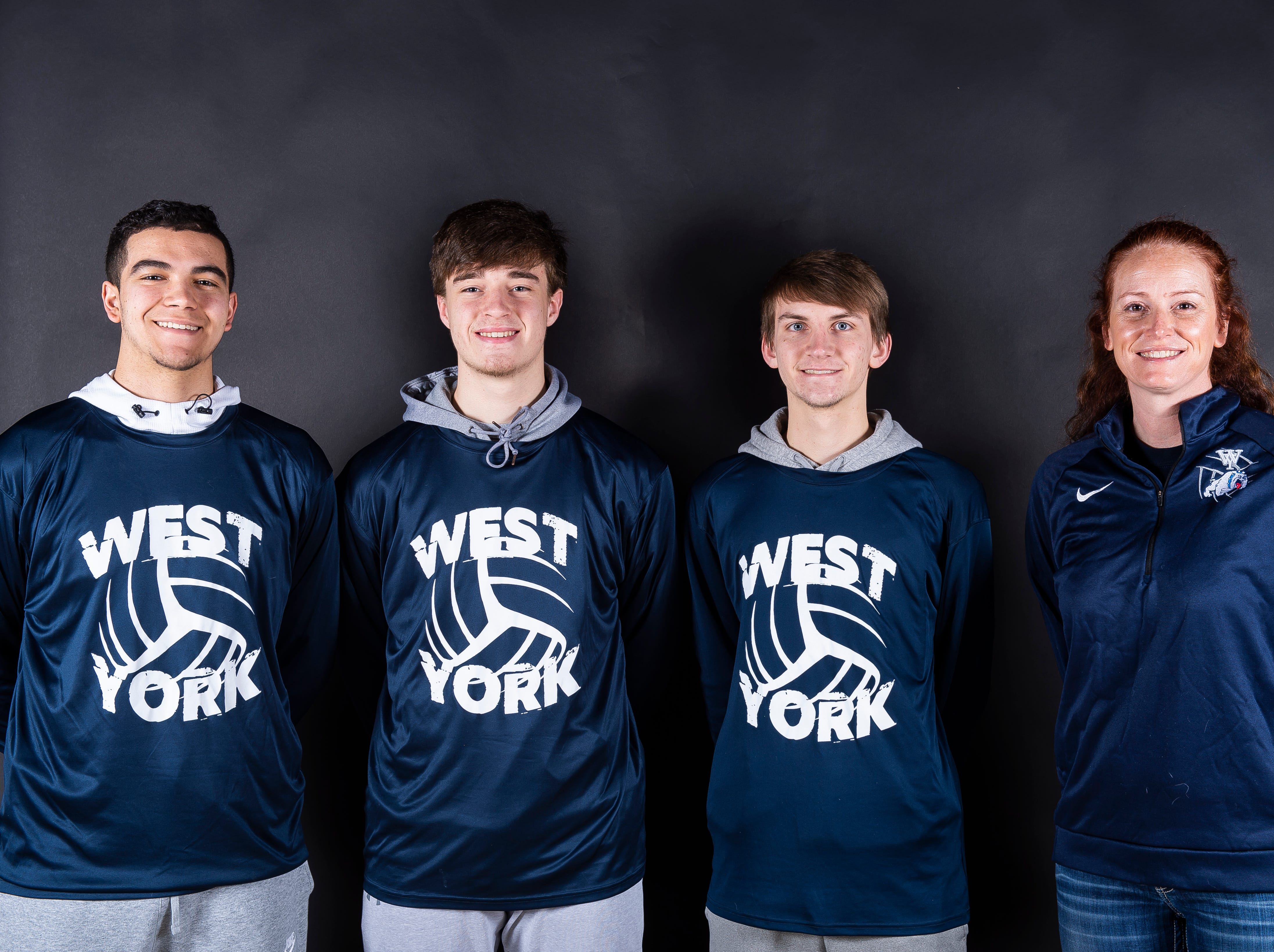 (From left) West York volleyball players Michael Washington, Alex McClellan and Adam Harsey pose with coach Amy Shoemaker in the GameTimePA photo booth during spring sports media day in York Sunday, March 10, 2019.