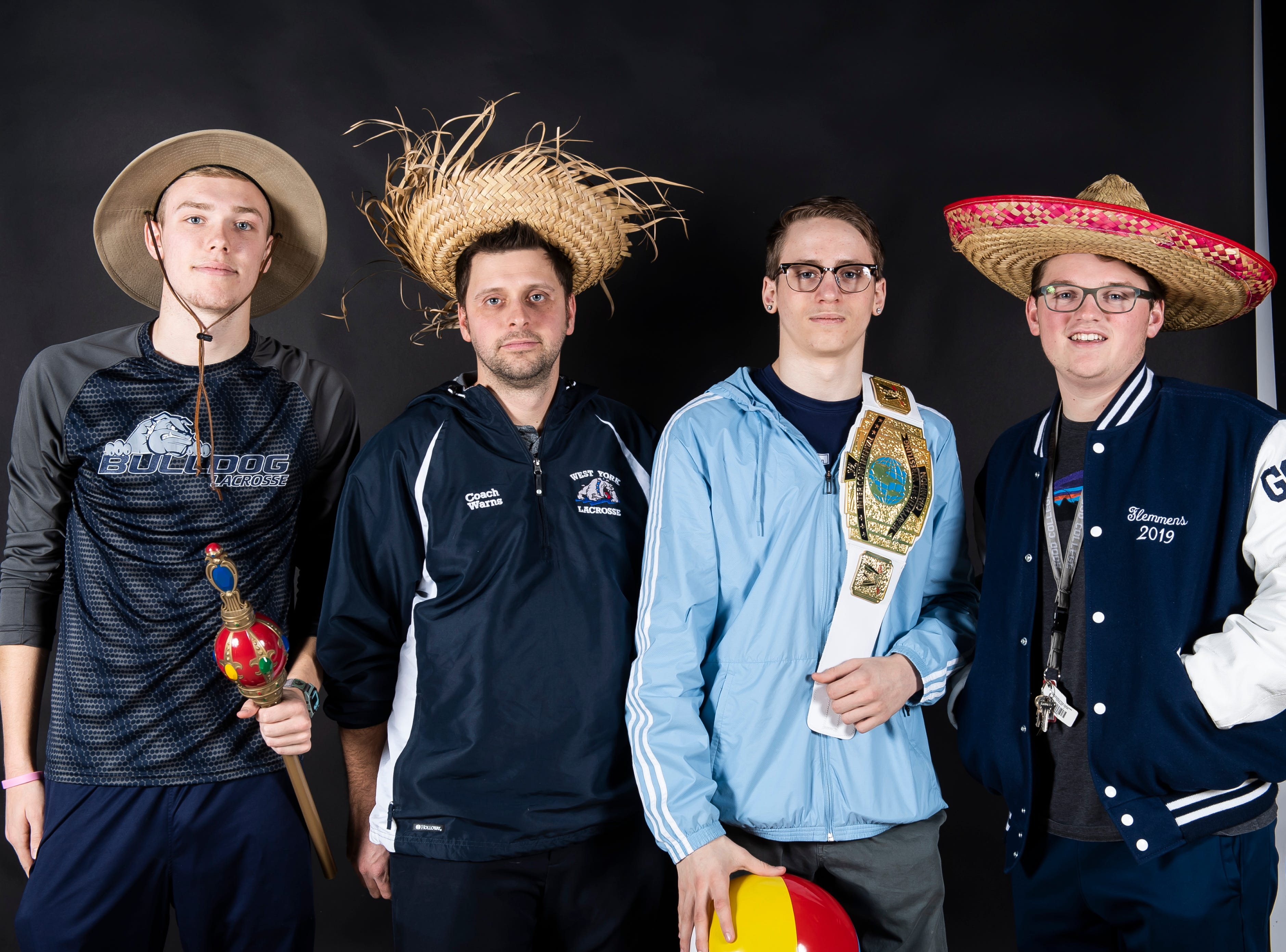 The West York lacrosse team strike a pose in the GameTimePA photo booth during spring sports media day in York Sunday, March 10, 2019.