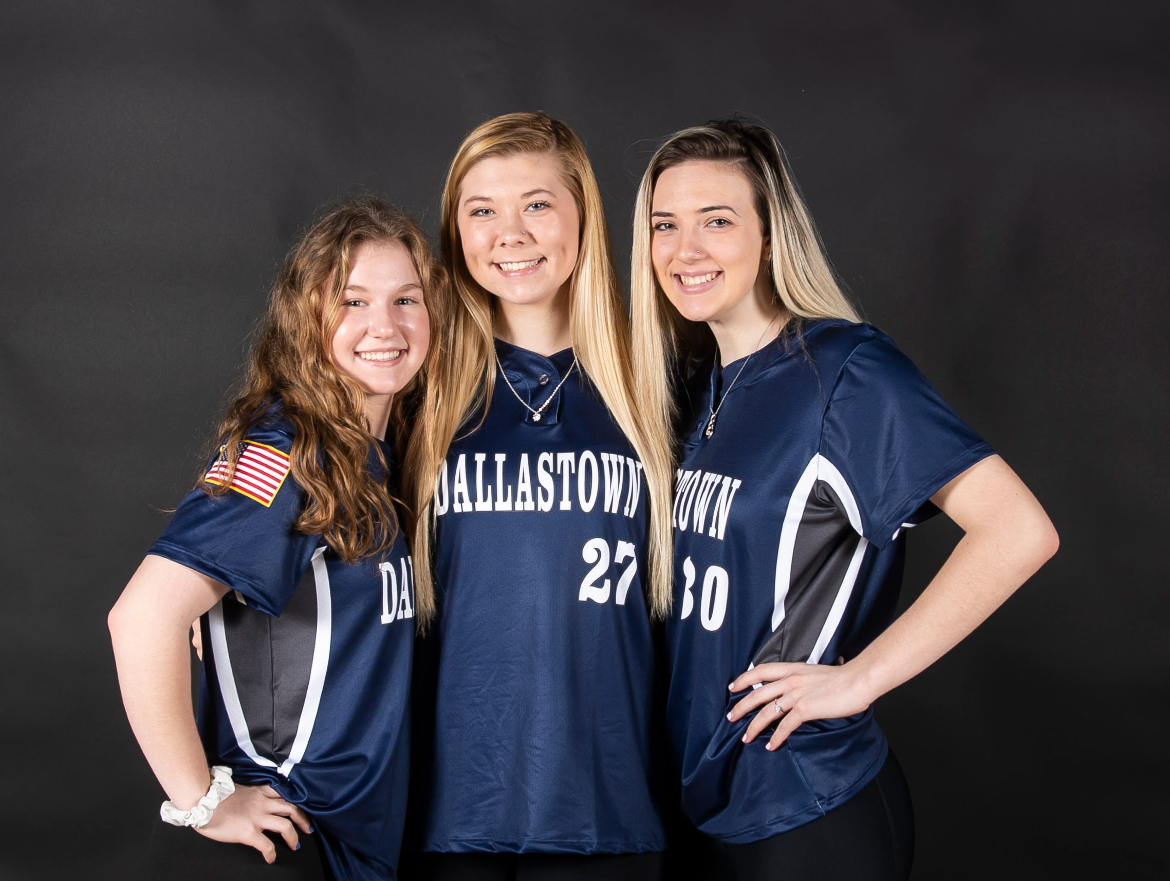 (From left) Dallastown softball players Elaina Winemiller, Kelsie Merriman and Shauna Stotler pose in the GameTimePA photo booth during spring sports media day in York Sunday, March 10, 2019.