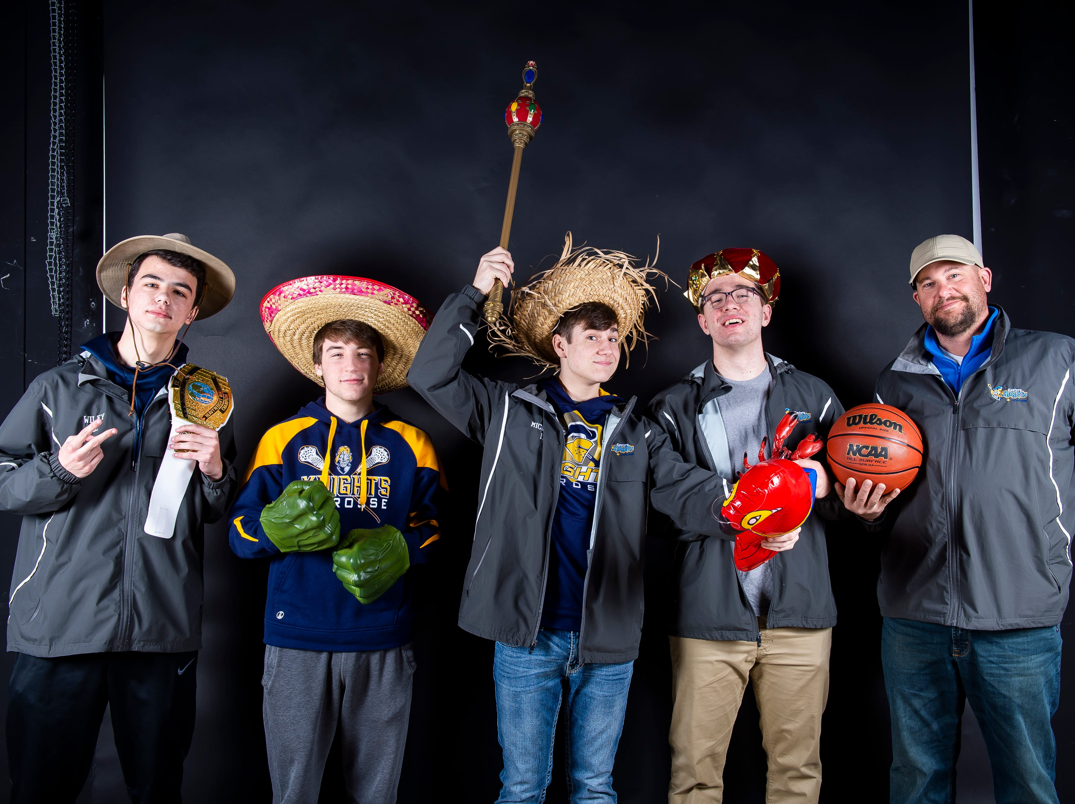 (From left) Eastern York lacrosse players Kade Wiley, Jake Crumling, Cadeyn Micahel and Zach Grove pose with coach Aaron Bankowski in the GameTimePA photo booth during spring sports media day in York Sunday, March 10, 2019.