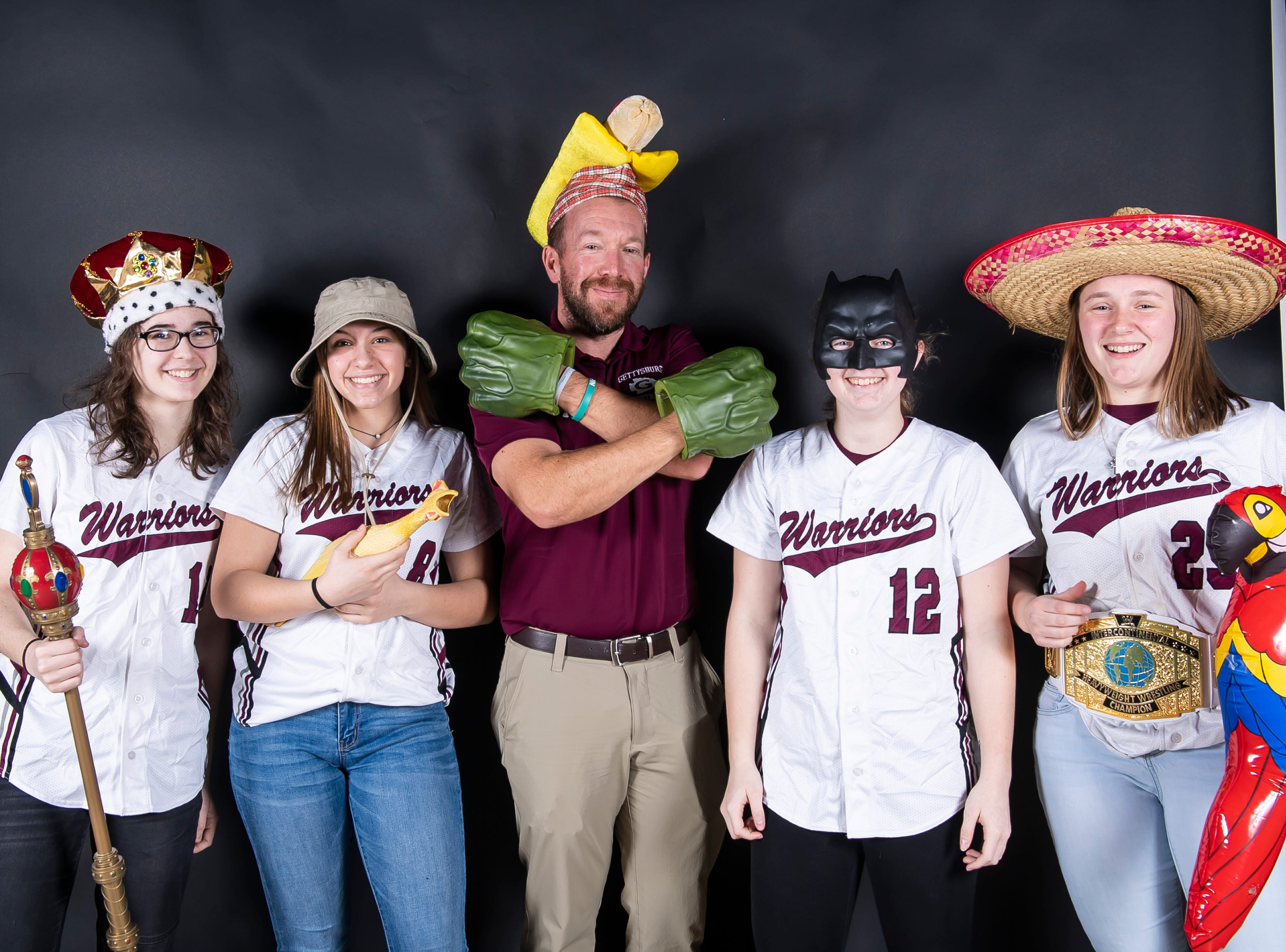 (From left) Gettysburg softball's Hayley Sisney, Kaelyn Blocher, coach Max Laing, Jenna Brase and Rachel Keller strike a pose in the GameTimePA photo booth during spring sports media day in York Sunday, March 10, 2019.