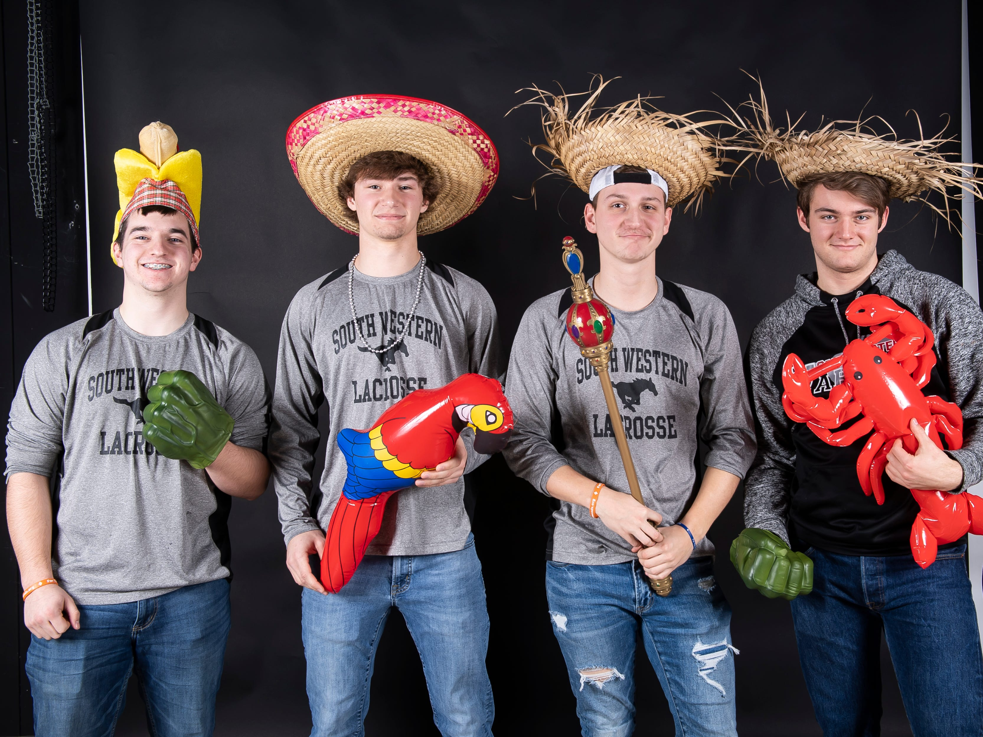 (From left) South Western boys lacrosse players Nick Boone, Ben Smith, James Strausbaugh and Dana McFalls strike a pose in the GameTimePA photo booth during spring sports media day in York Sunday, March 10, 2019.