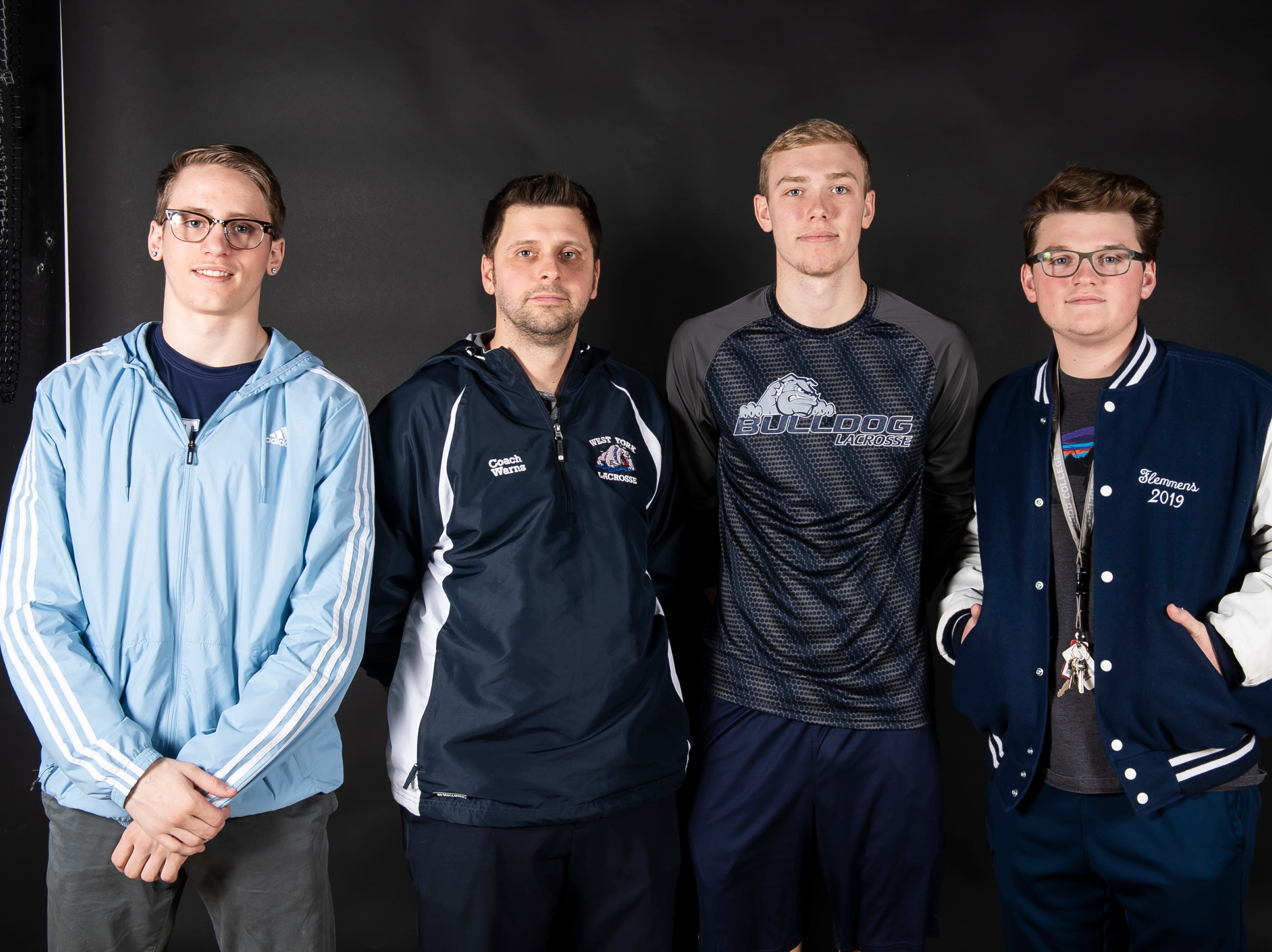 (From left) West York lacrosse's Jordan Billet, coach Joe Warns, Colby Goodling and Samuel Flemmens pose in the GameTimePA photo booth during spring sports media day in York Sunday, March 10, 2019.