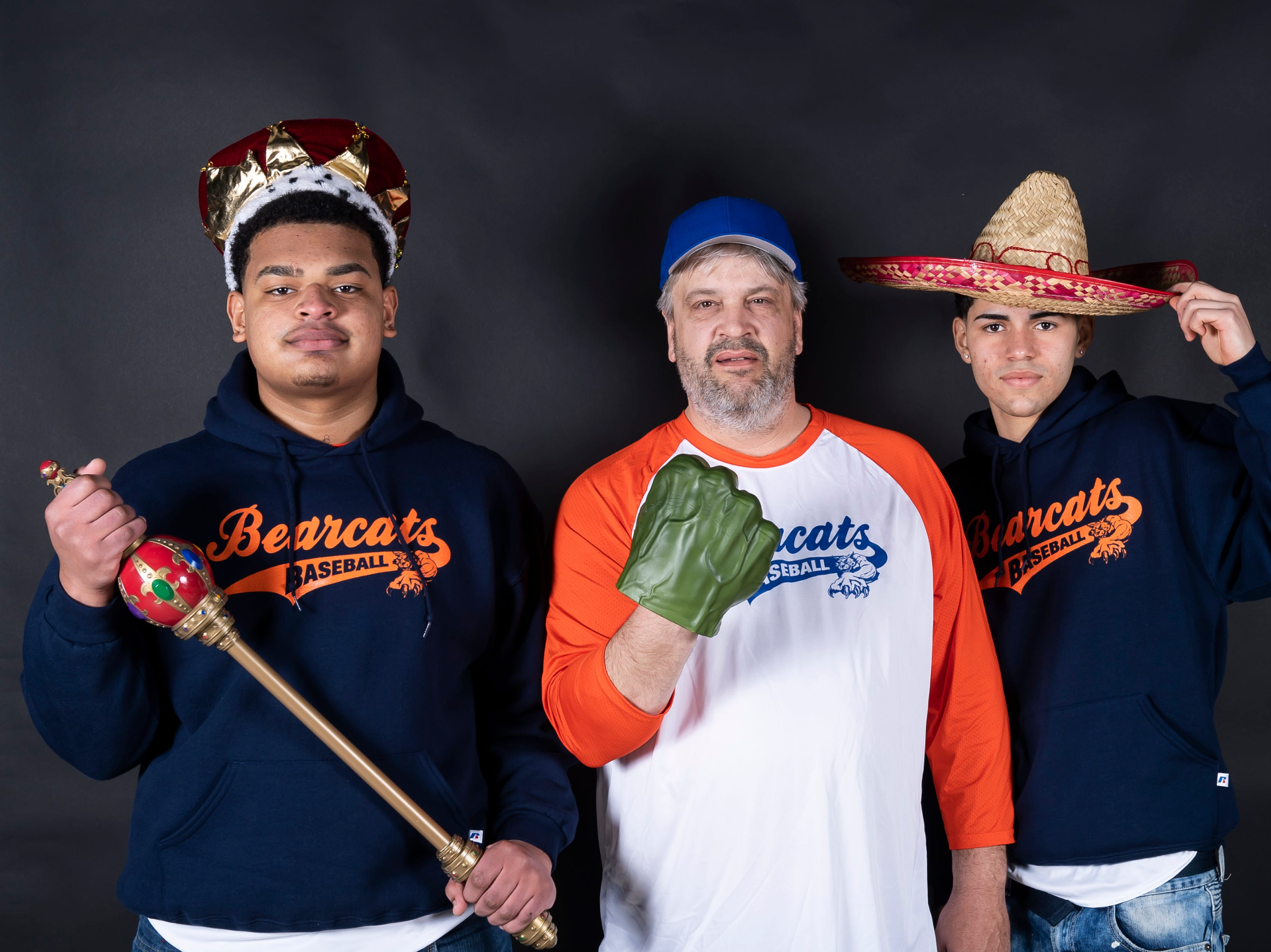 (From left) York High baseball's Joseph Garabito, coach Dave Carr and Bryan Seda strike a pose in the GameTimePA photo booth during spring sports media day in York Sunday, March 10, 2019.