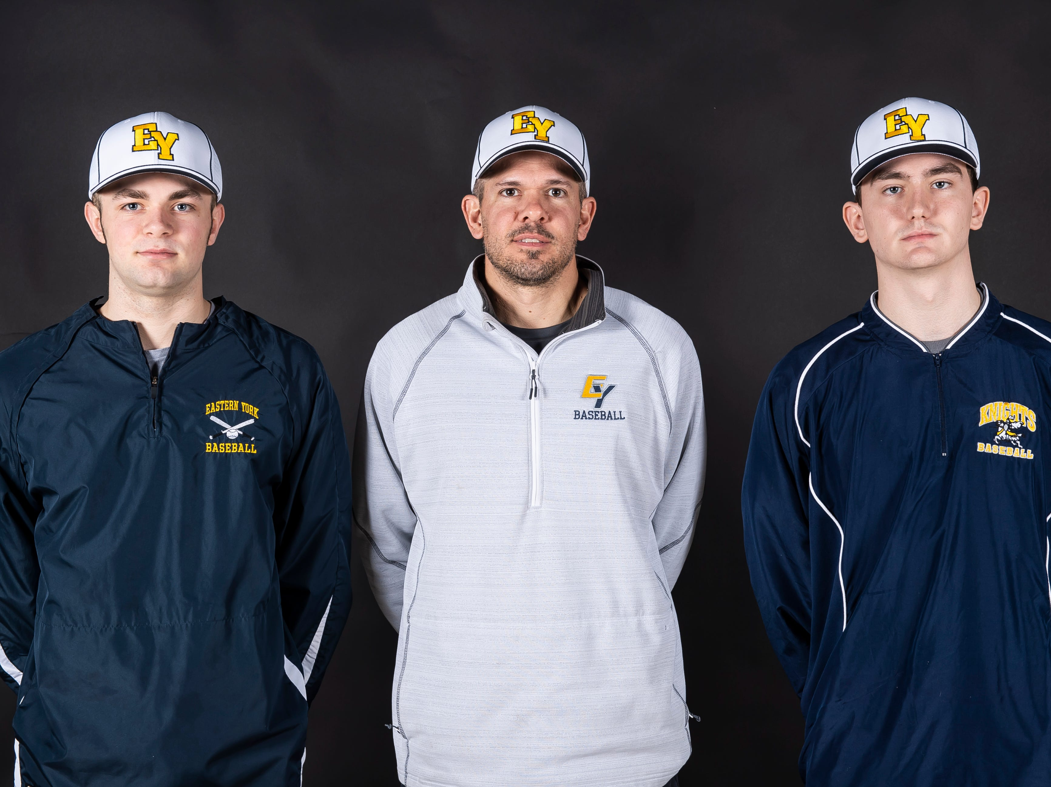 Eastern York baseball coach Brett Heiser poses with players Bren Taylor, left, and Emmit Silar in the GameTimePA photo booth during spring sports media day in York Sunday, March 10, 2019.