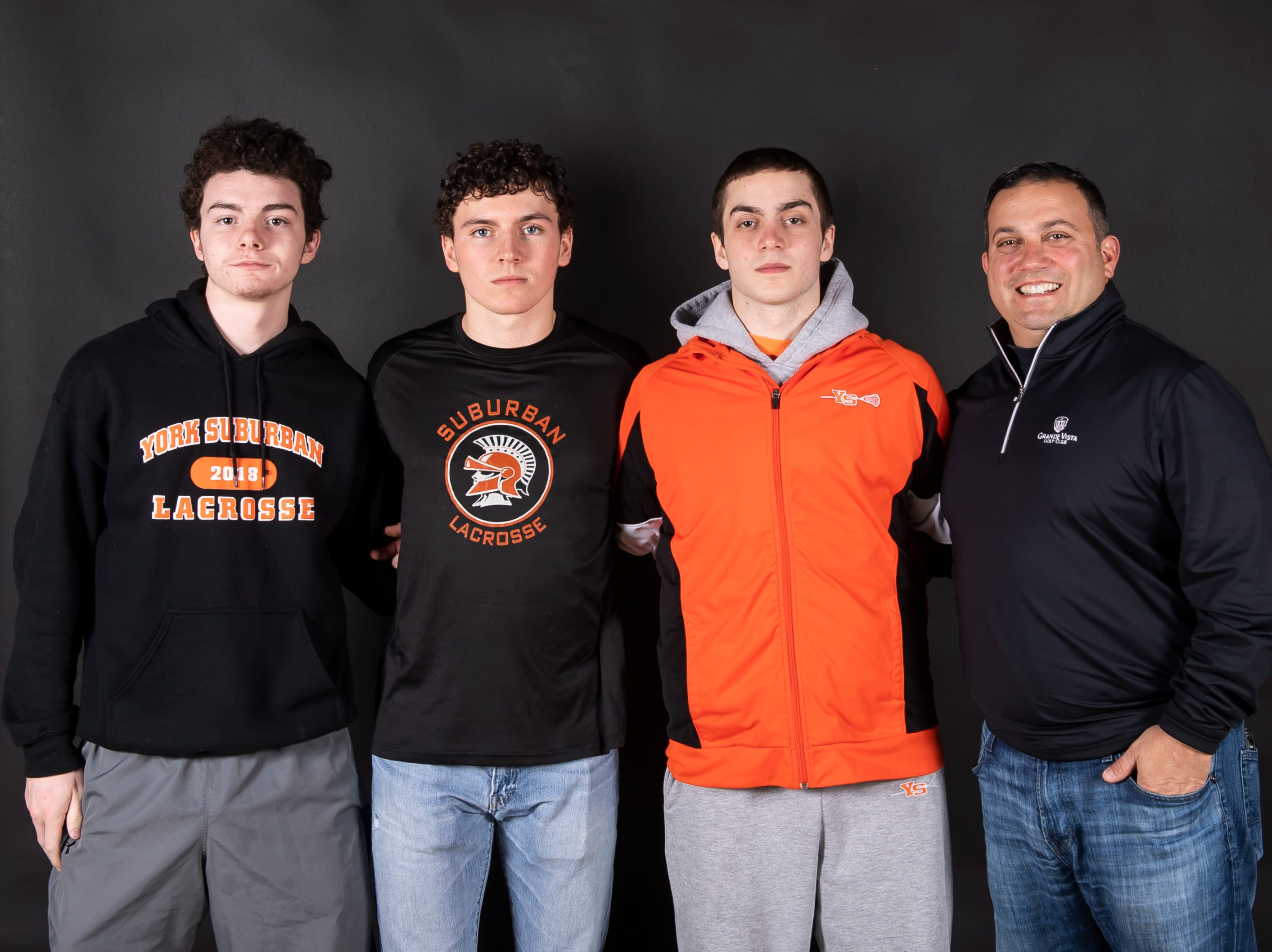 (From left) York Suburban lacrosse's Justin Shocker, Evan Lecates, Dominic Corto and coach Frank Corto pose in the GameTimePA photo booth during spring sports media day in York Sunday, March 10, 2019.