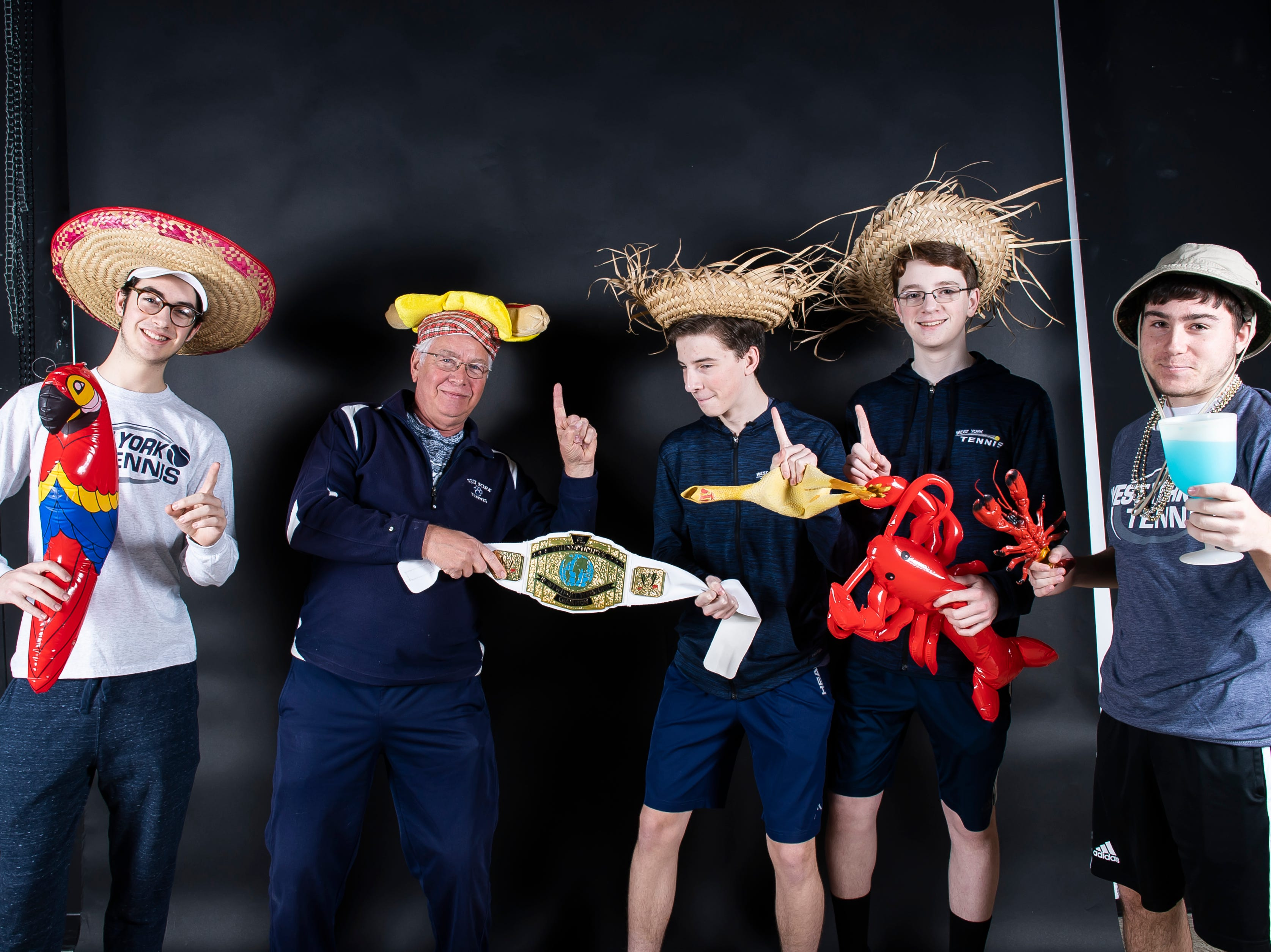 (From left) West York tennis team's Brendan Guy, coach Pete Kerns, Augie Citrone, Jack Citrone and Griffin Conaway pose in the GameTimePA photo booth during spring sports media day in York Sunday, March 10, 2019.