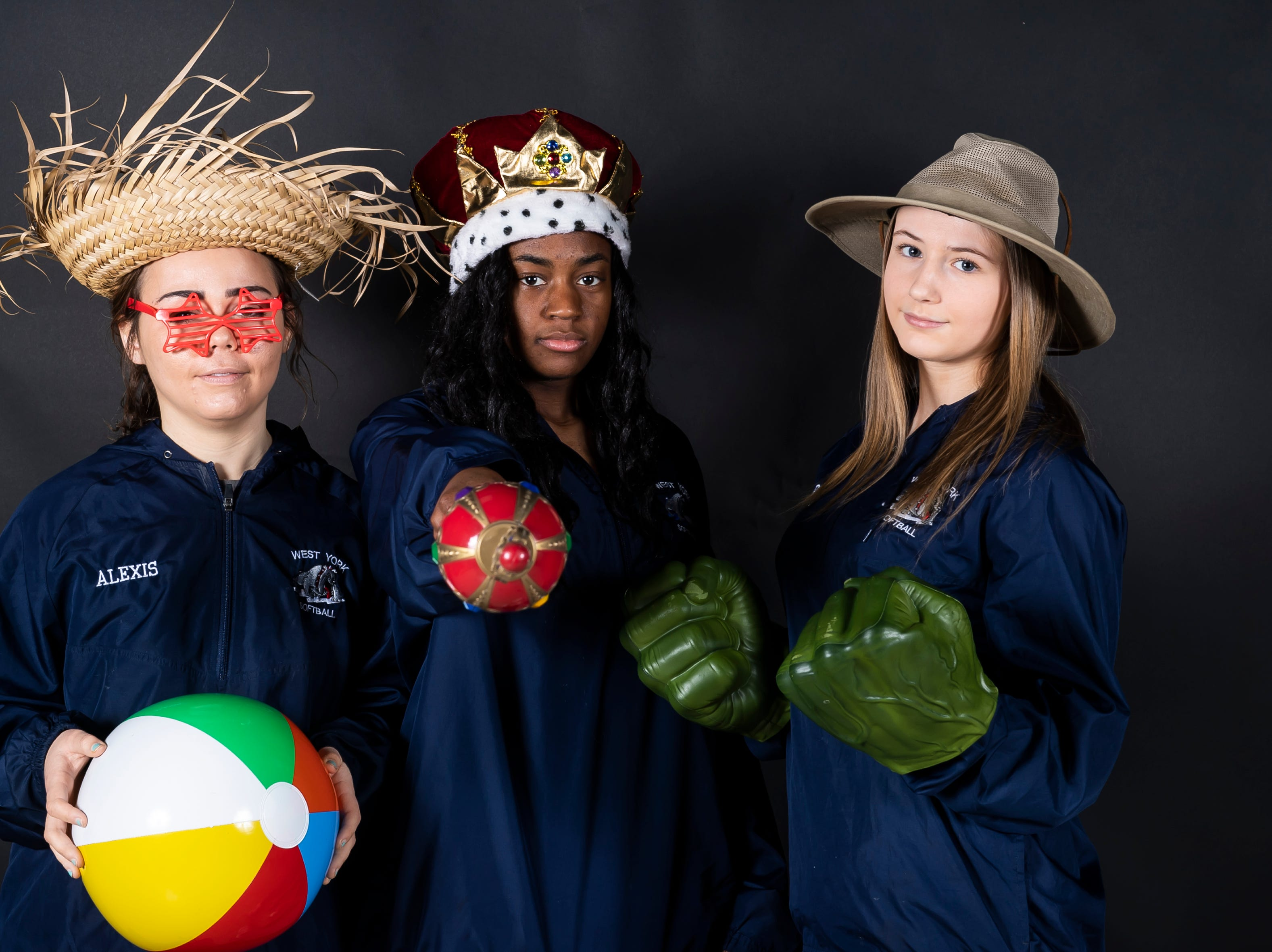 West York softball players pose in the GameTimePA photo booth during spring sports media day in York Sunday, March 10, 2019.
