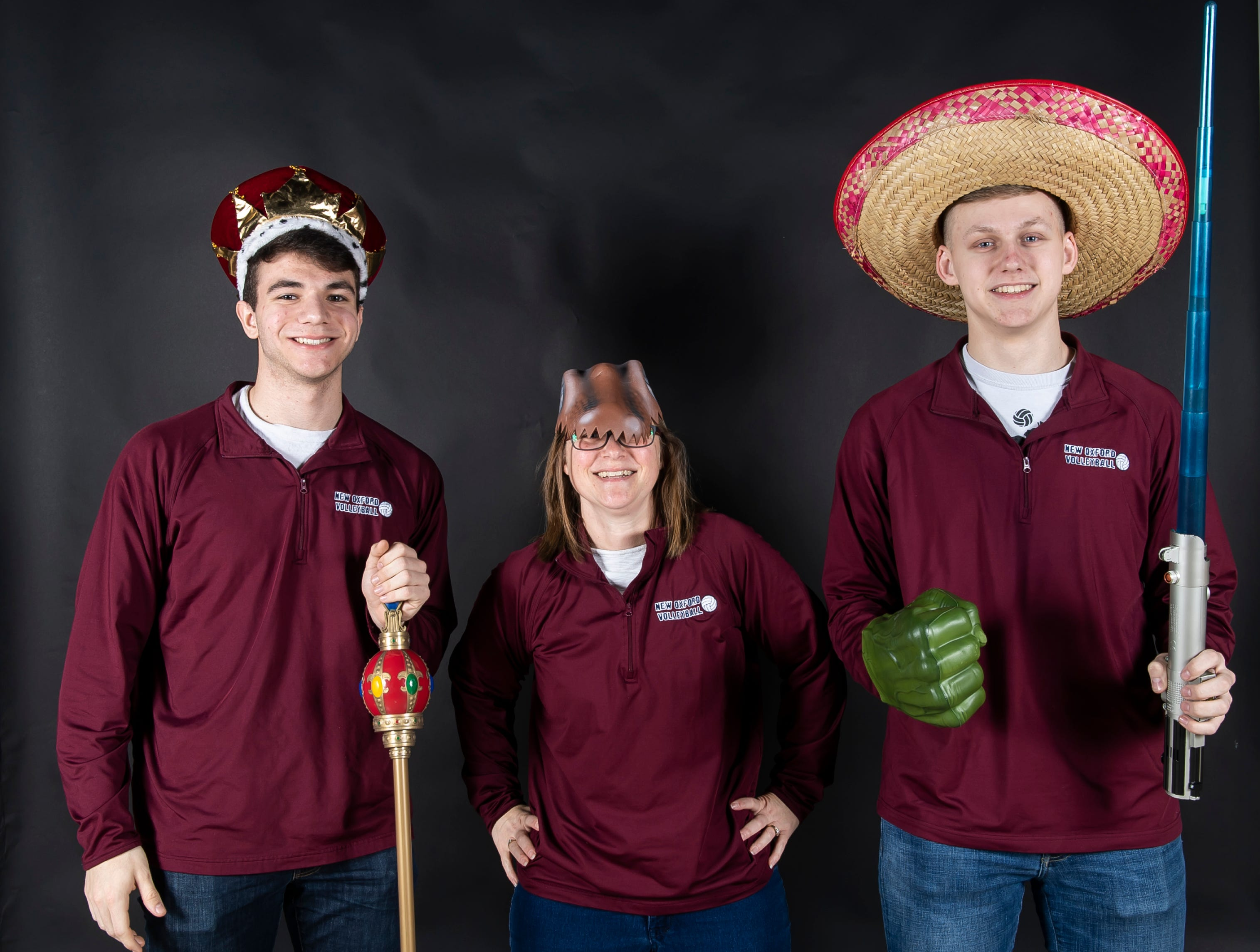 (From left) New Oxford volleyball's Matthew Faust, coach Rachel Booth and Joe Angleberger strike a pose in the GameTimePA photo booth during spring sports media day in York Sunday, March 10, 2019.