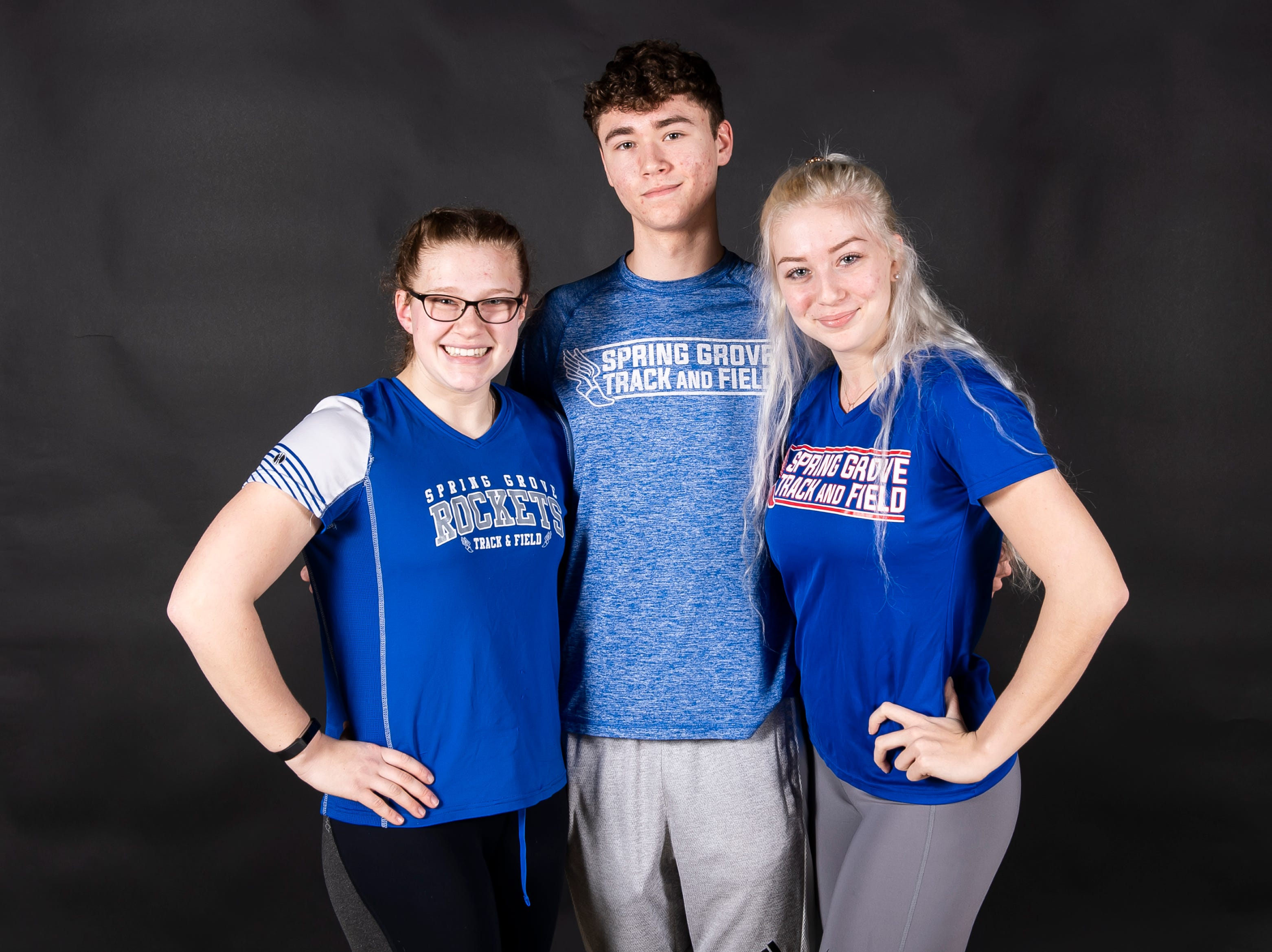 (From left) Spring Grove track and field athletes Ashley Dressler, Colson Martin and Angel Rohrbaugh pose in the GameTimePA photo booth during spring sports media day in York Sunday, March 10, 2019.