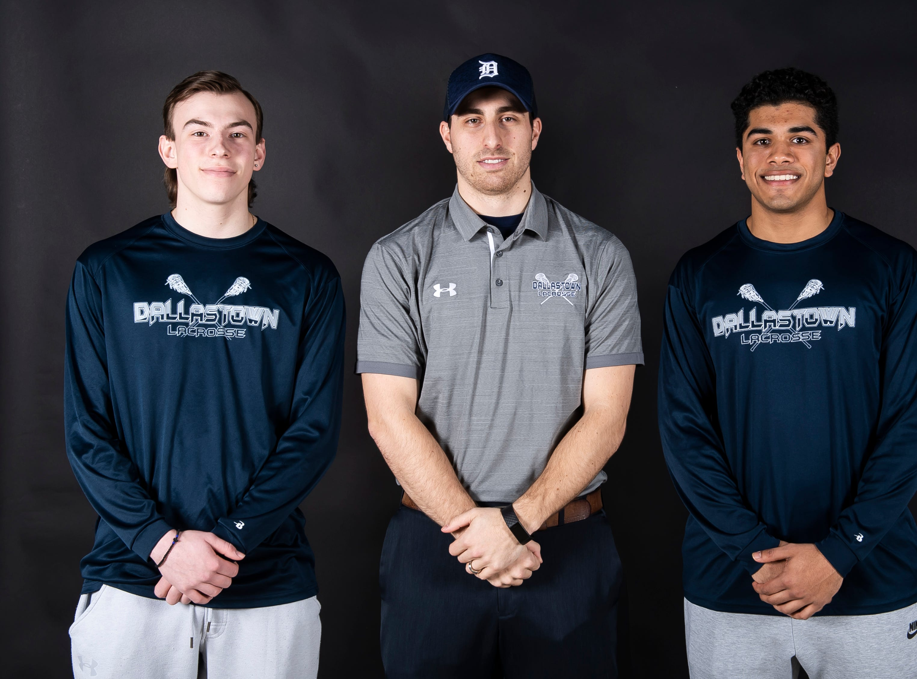 (From left) Dallastown lacrosse's Jay Shifflet, coach Joe Slessinger and Joshua Sebastian pose in the GameTimePA photo booth during spring sports media day in York Sunday, March 10, 2019.
