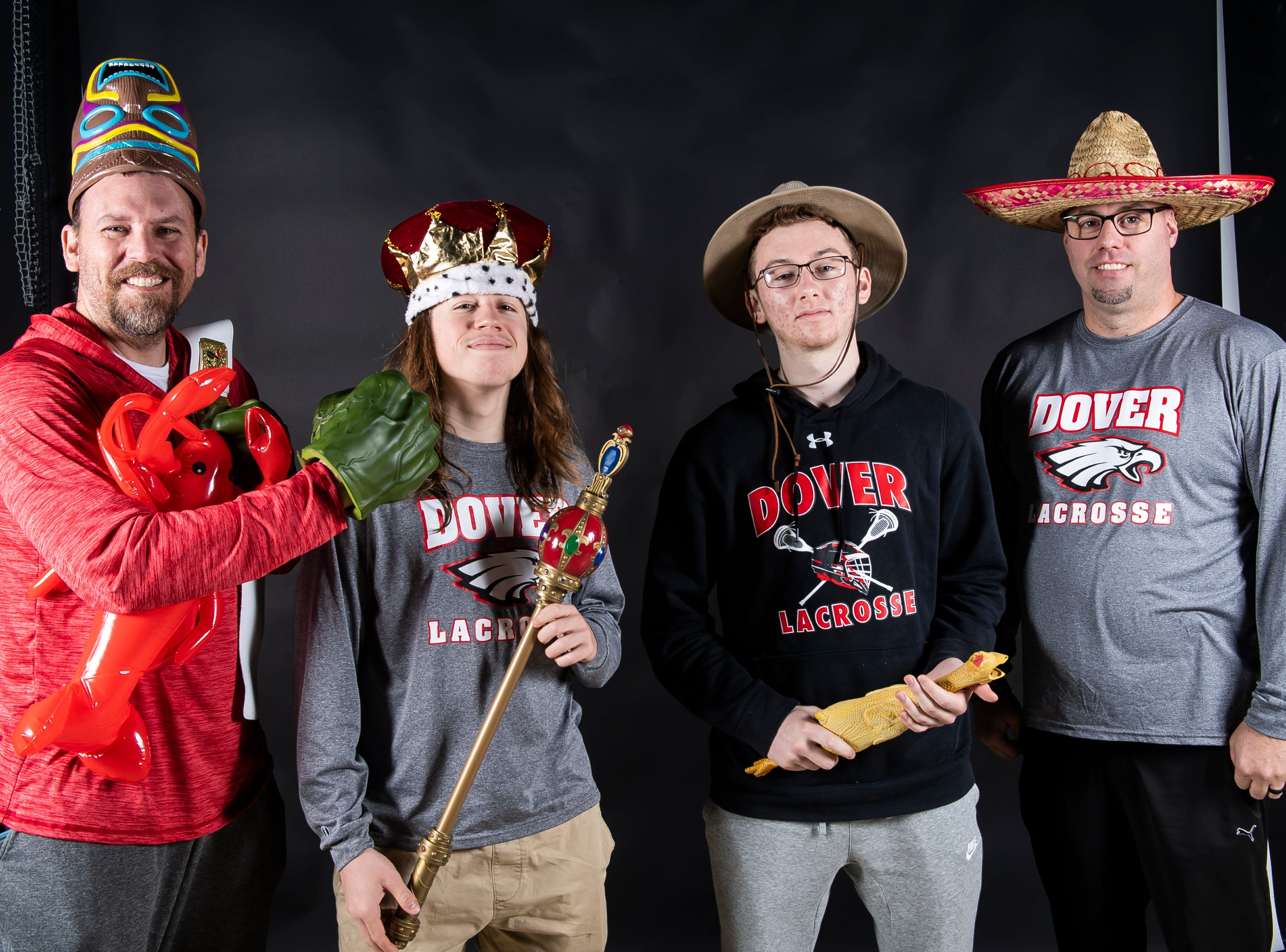 (From left) Dover boys lacrosse's coach Brian Chamberlain Sr., Cole Brickley, Brian Chamberlain and coach Bob Boyer strike a pose in the GameTimePA photo booth during spring sports media day in York Sunday, March 10, 2019.