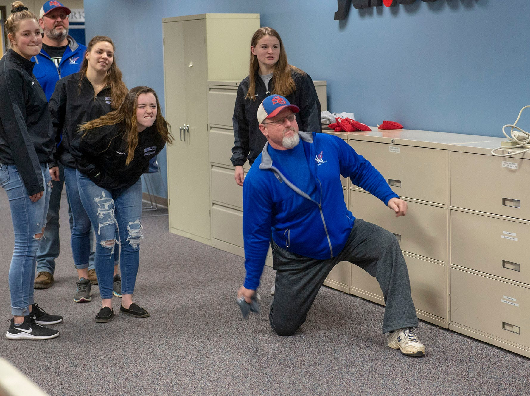 Trying to toss the beanbags about 45 feet brought at least one Spring Grove coach to his knees at GameTimePA's YAIAA Spring Media Day on Sunday, March 10, 2019.