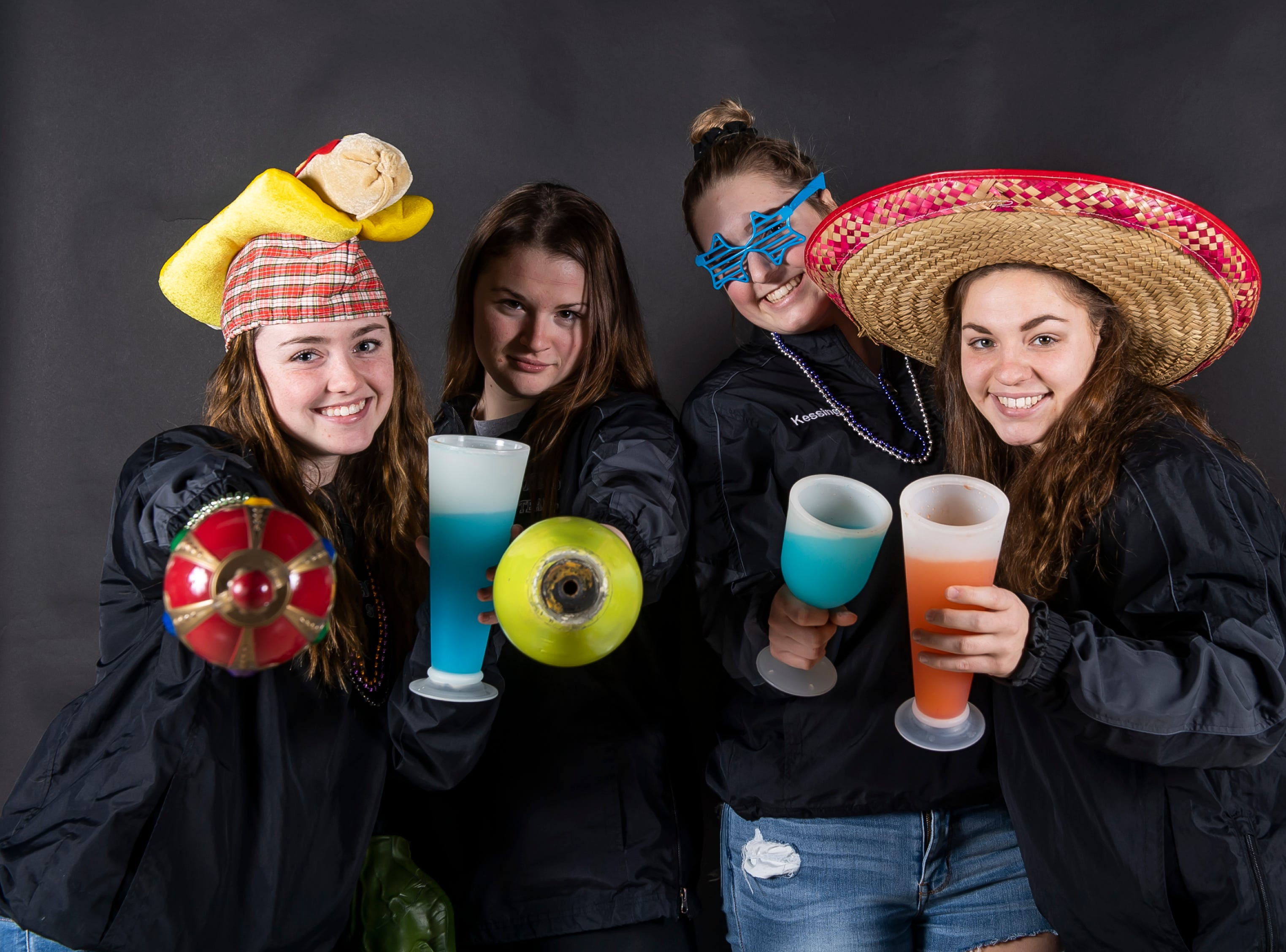 (From left) Spring Grove softball players Bailey Rapson, Hannah Gartrell, Hailey Kessinger and Bryn Sporer strike a pose in the GameTimePA photo booth during spring sports media day in York Sunday, March 10, 2019.