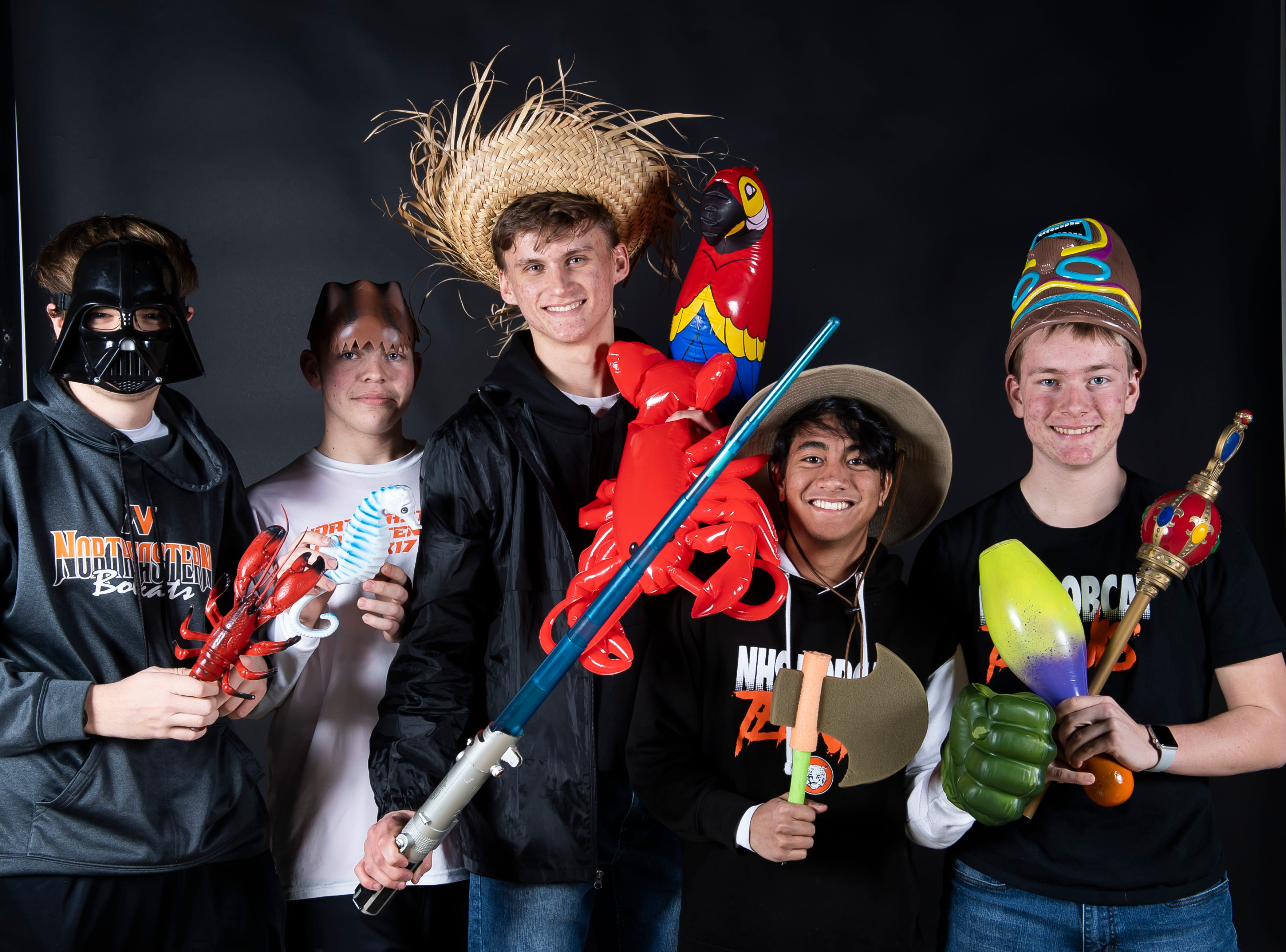 Northeastern tennis players strike a pose in the GameTimePA photo booth during spring sports media day in York Sunday, March 10, 2019.