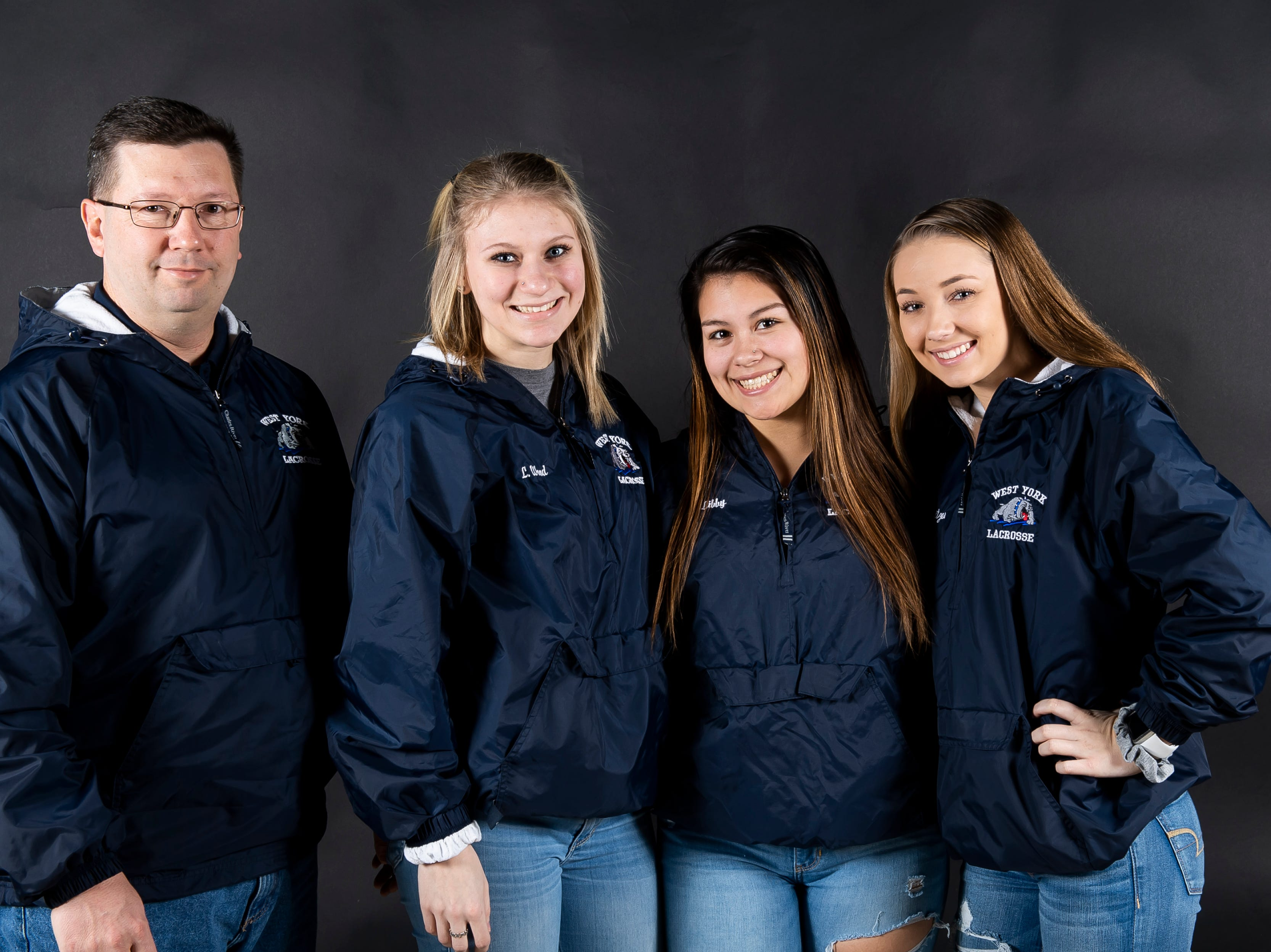 (From left) West York lacrosse coach Marcus Sweitzer and players Lizzie Wood, Libby Bahoric and Sydney Sweitzer pose in the GameTimePA photo booth during spring sports media day in York Sunday, March 10, 2019.