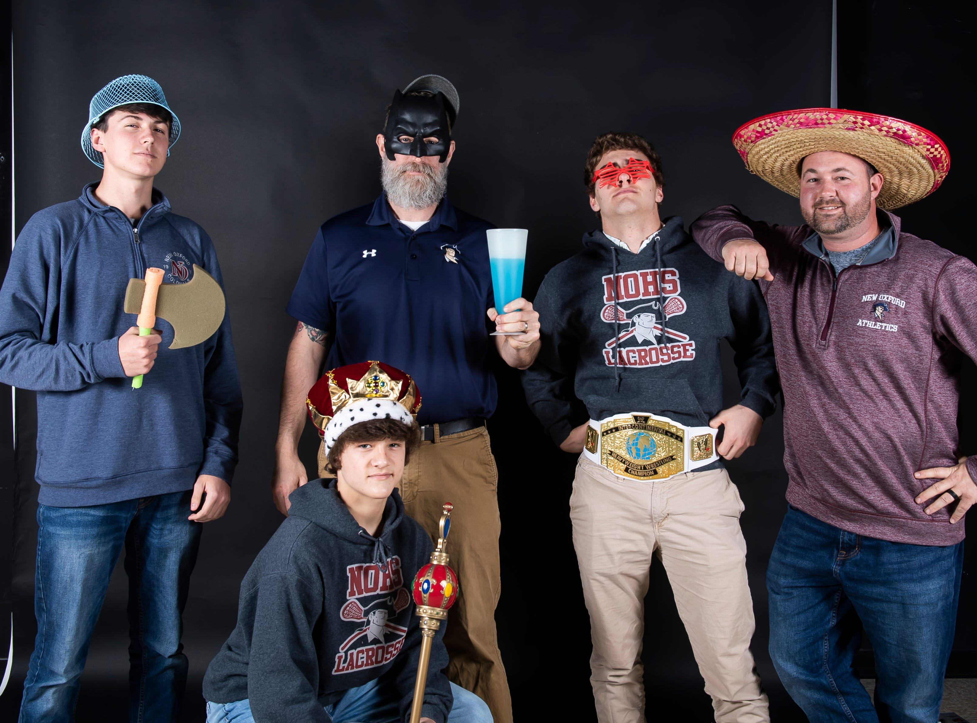 New Oxford boys lacrosse team members strike a pose in the GameTimePA photo booth during spring sports media day in York Sunday, March 10, 2019.