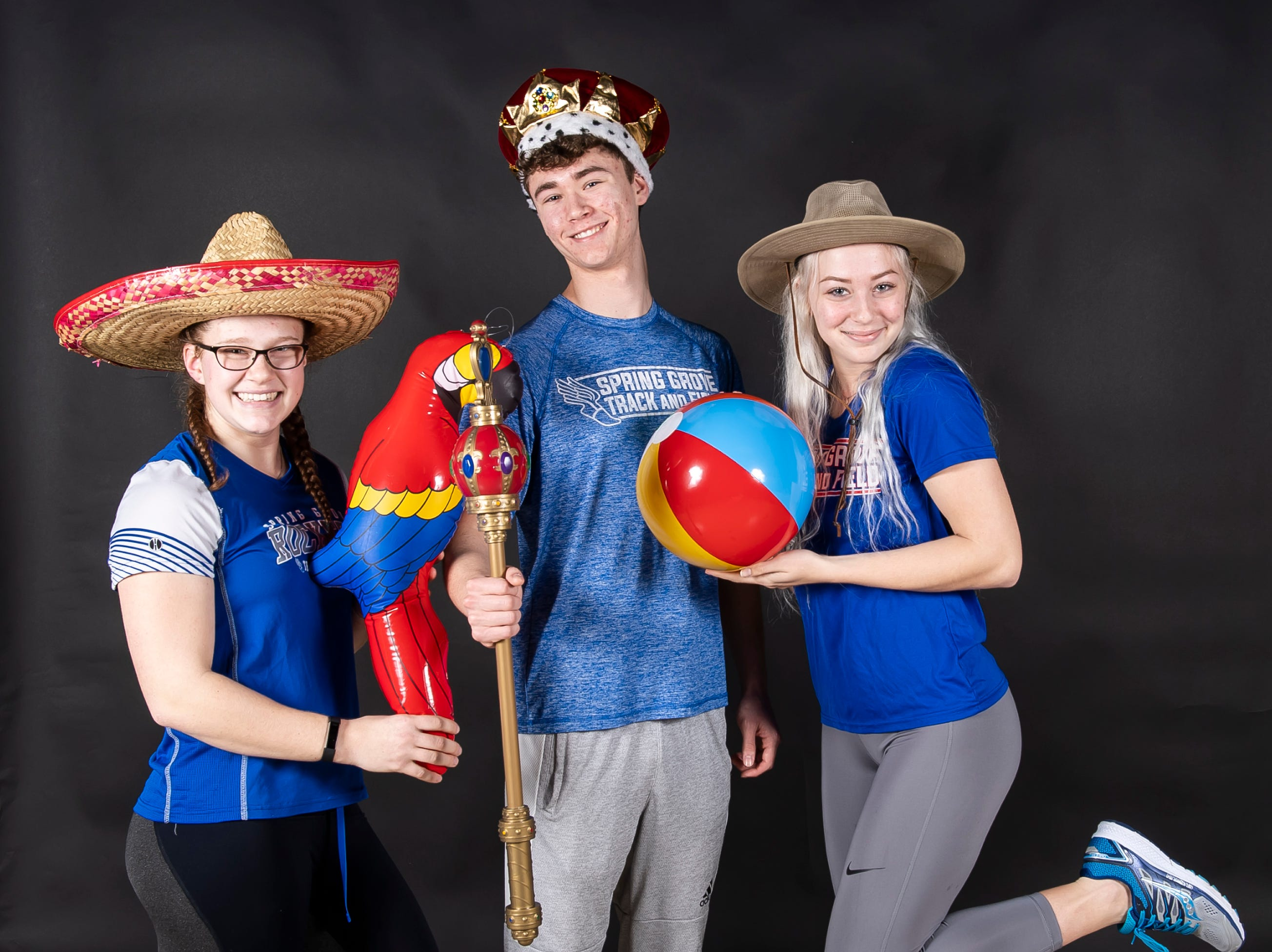 (From left) Spring Grove track and field athletes Ashley Dressler, Colson Martin and Angel Rohrbaugh strike a pose in the GameTimePA photo booth during spring sports media day in York Sunday, March 10, 2019.