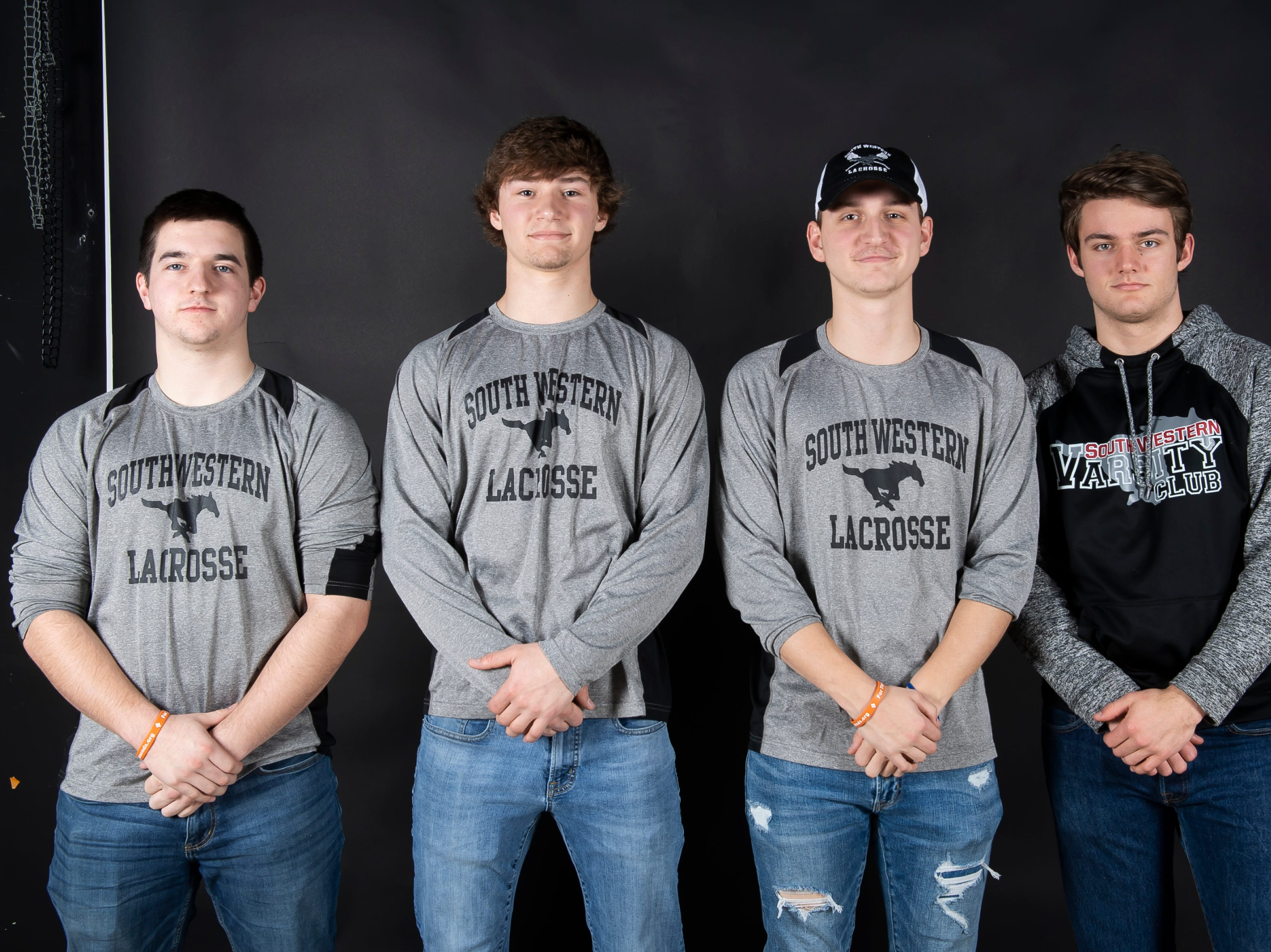 (From left) South Western boys lacrosse players Nick Boone, Ben Smith, James Strausbaugh and Dana McFalls pose in the GameTimePA photo booth during spring sports media day in York Sunday, March 10, 2019.