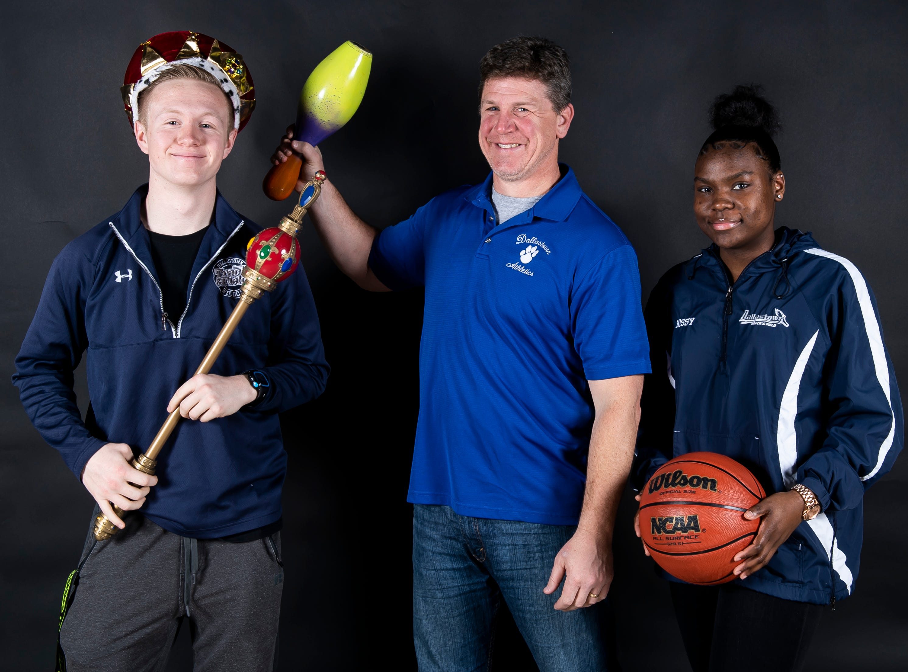 Dallastown track and field coach Neil Gutekunst and athletes Thomas Viens and Lynnethia Shanks pose in the GameTimePA photo booth during spring sports media day in York Sunday, March 10, 2019.