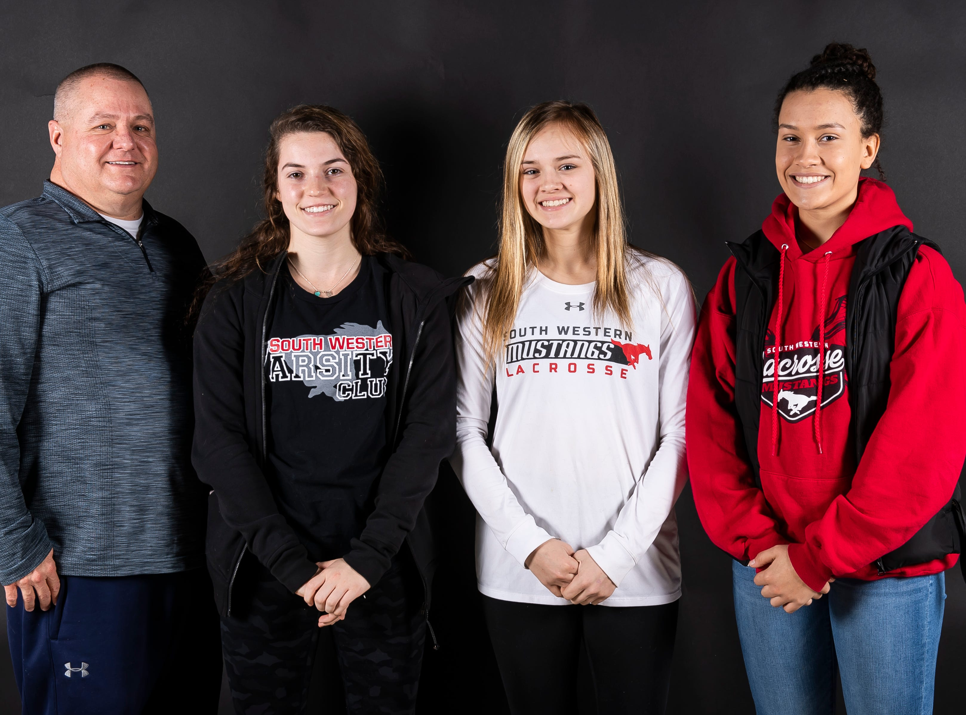 (From left) South Western girls lacrosse coach Randy Kavanaugh poses with players Jordan Gertz, Caitlyn Coates and Sophie Mace in the GameTimePA photo booth during spring sports media day in York Sunday, March 10, 2019.