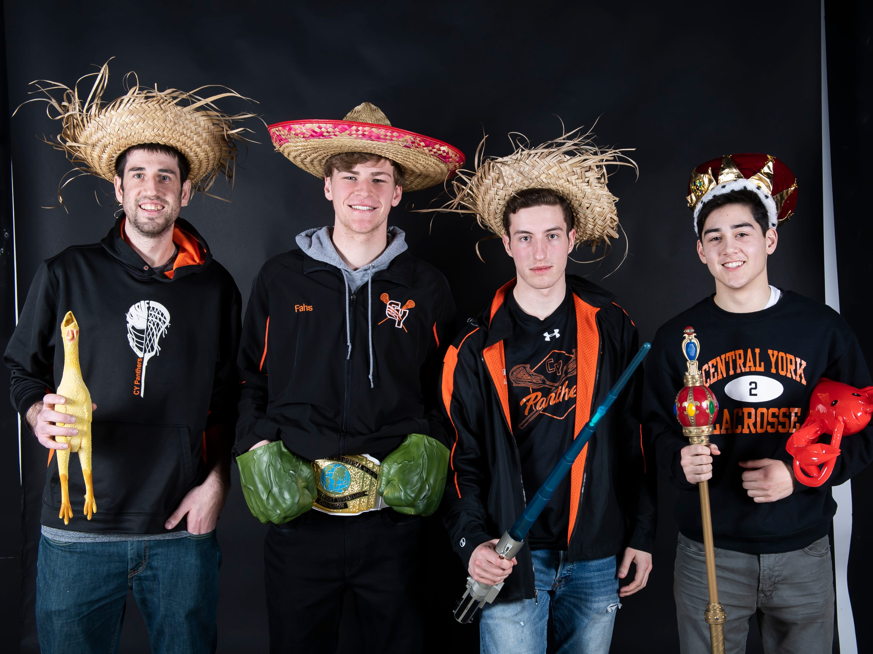 (From left) Central York lacrosse's coach Ryan Muller, Ryan Fans, Aaron Czech and Drake Little strike a pose in the GameTimePA photo booth during spring sports media day in York Sunday, March 10, 2019.