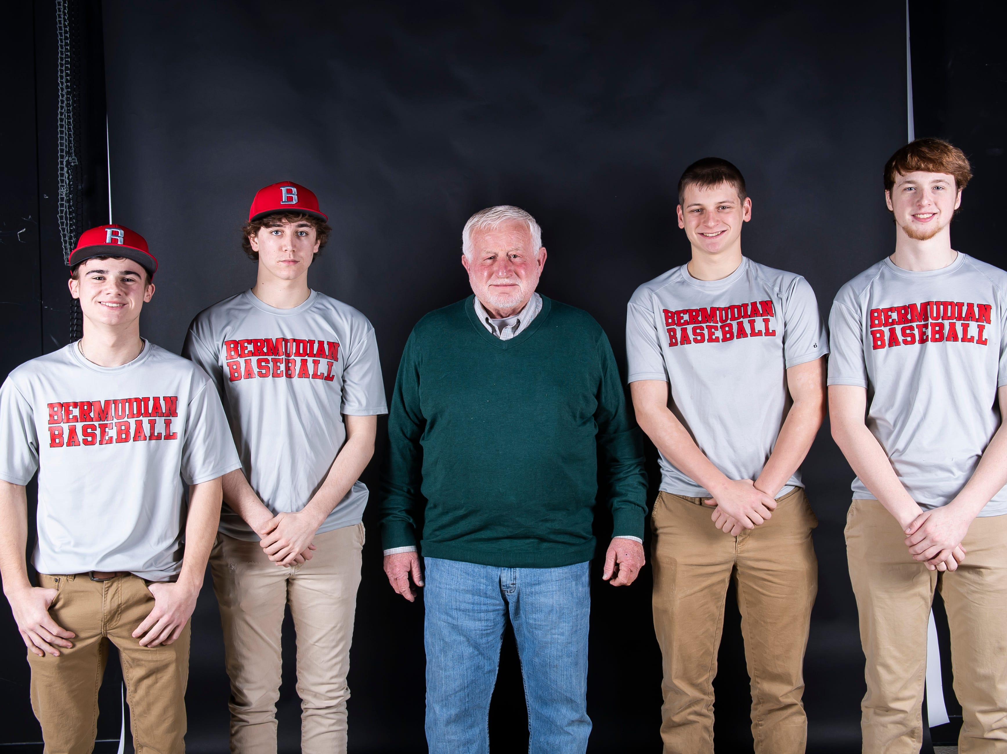 (From left) Bermudian Springs baseball players Aden Juelich, Tyler Sims, coach Bruce Reinert, Tyler Reinert and Shane Starner pose in the GameTimePA photo booth during spring sports media day in York Sunday, March 10, 2019.