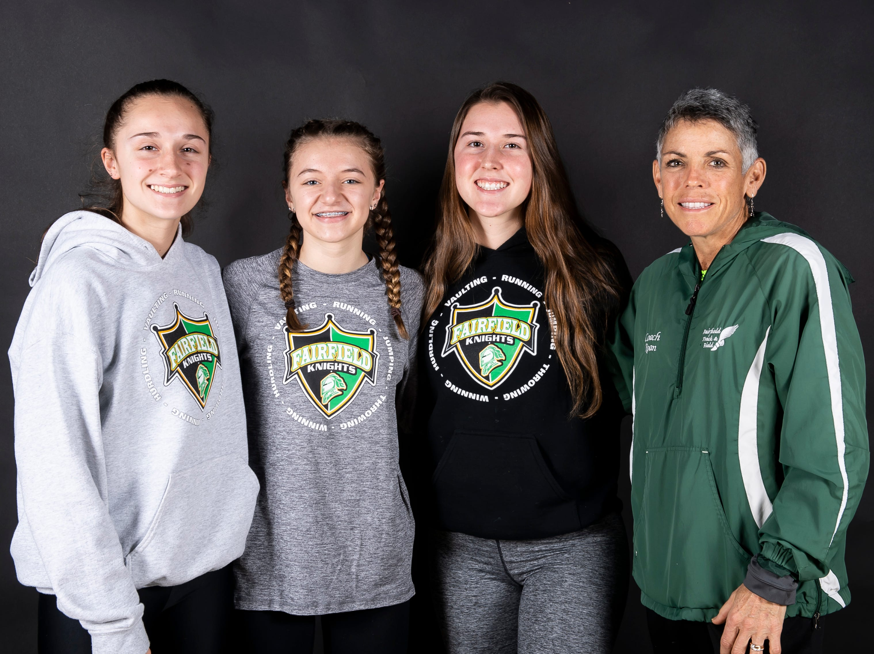 (From left) Fairfield girls track and field athletes Rio Strosnider, Morgan Dennison and Honey Strosnider pose with coach Marcia Roan in the GameTimePA photo booth during spring sports media day in York Sunday, March 10, 2019.
