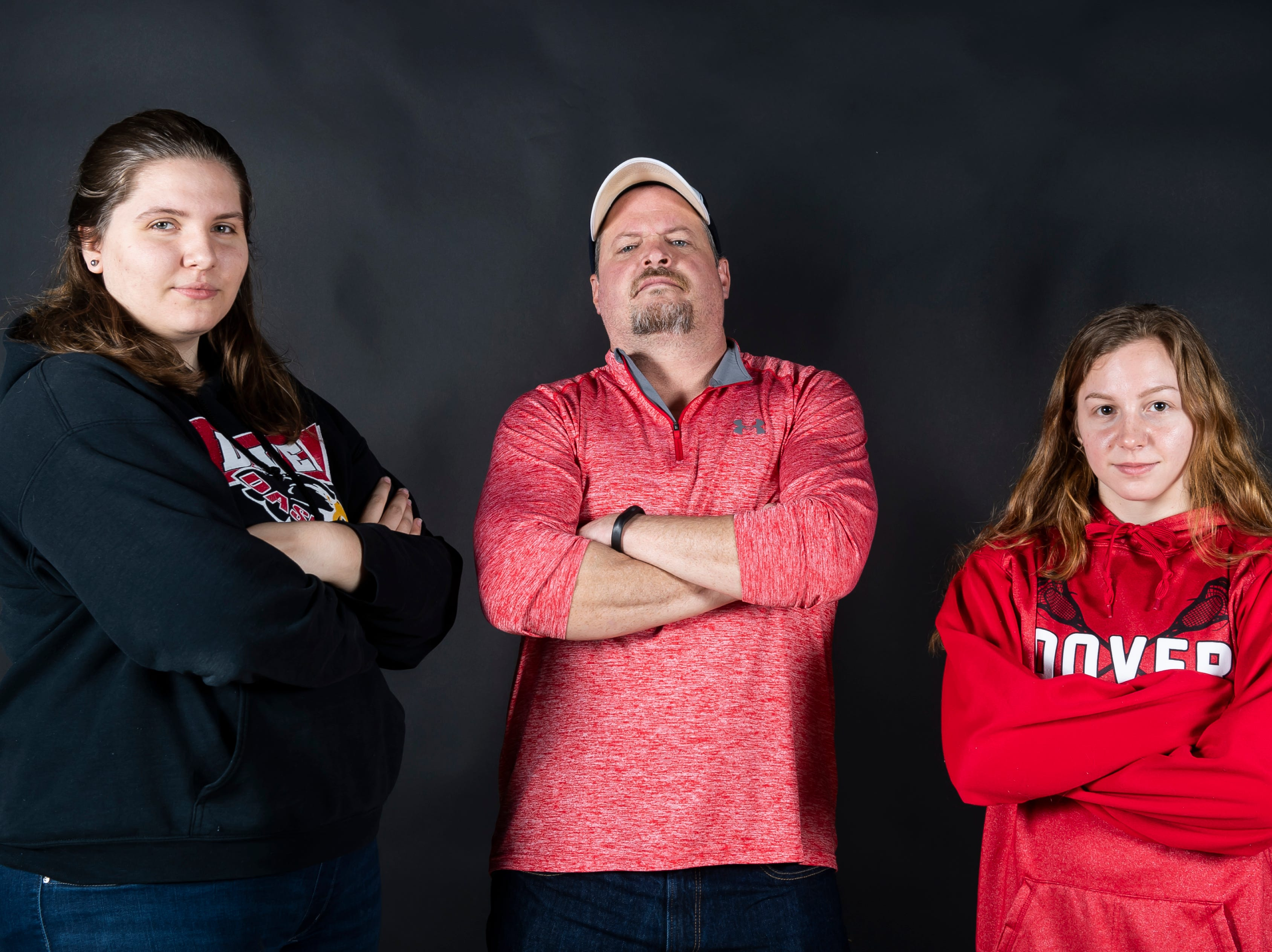 (From left) Dover lacrosse player Katie Sweitzer, coach Bryan Gamble and player Paige Lantz pose in the GameTimePA photo booth during spring sports media day in York Sunday, March 10, 2019.