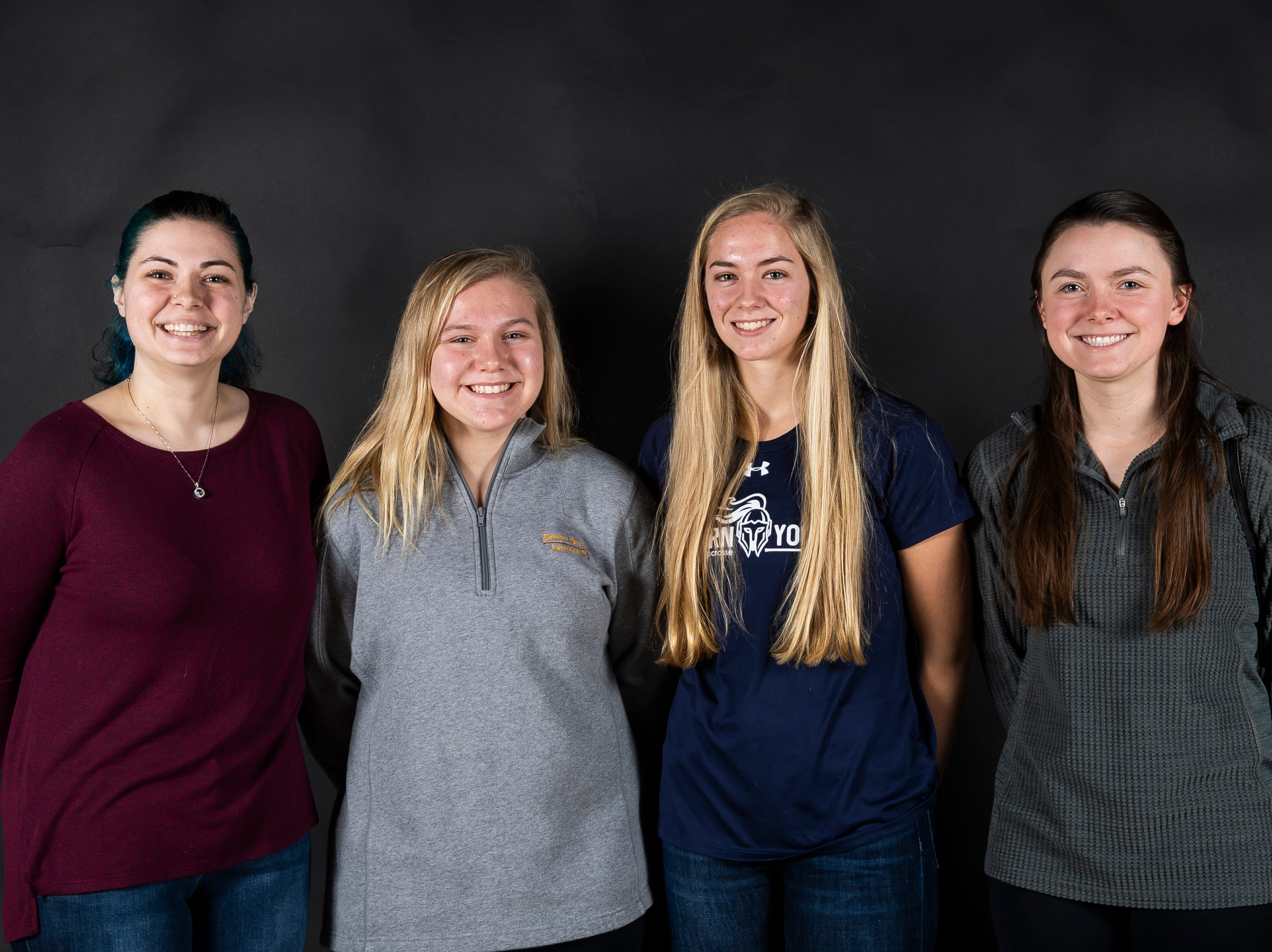 Eastern York lacrosse coaches Rachel Strzelecki, far left, and Jessica Mazzur, far right, pose with players Haley Holtzinger and Addison Malone in the GameTimePA photo booth during spring sports media day in York Sunday, March 10, 2019.
