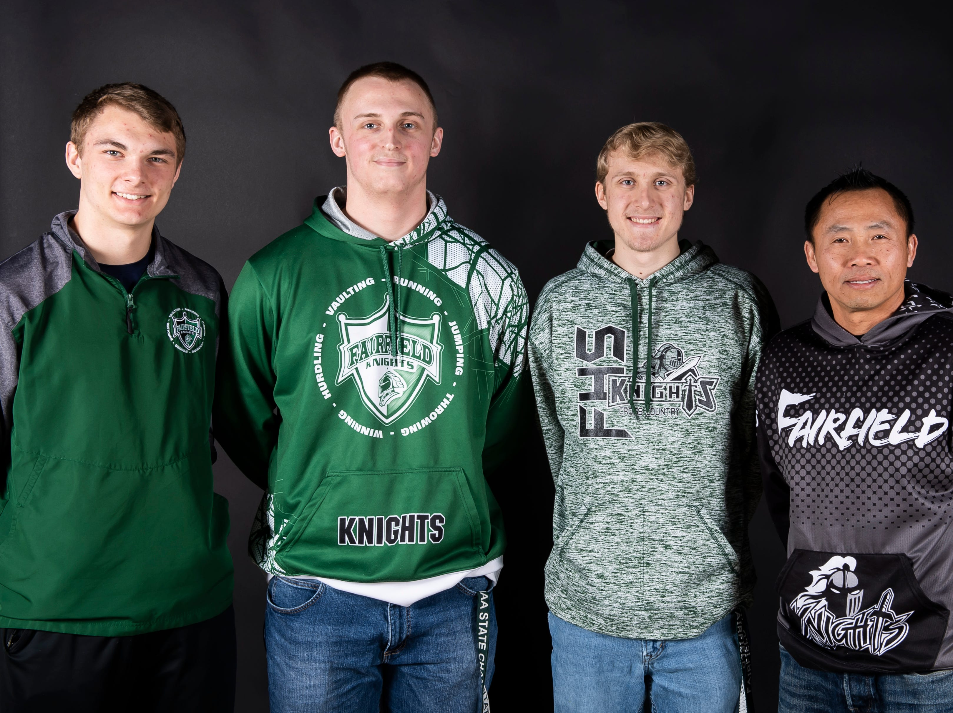 (From left) Fairfield boys track and field athletes Garrett Stadler, Travis Zimmerman and Noah Hazlett pose with coach Phomma Phanhthy in the GameTimePA photo booth during spring sports media day in York Sunday, March 10, 2019.