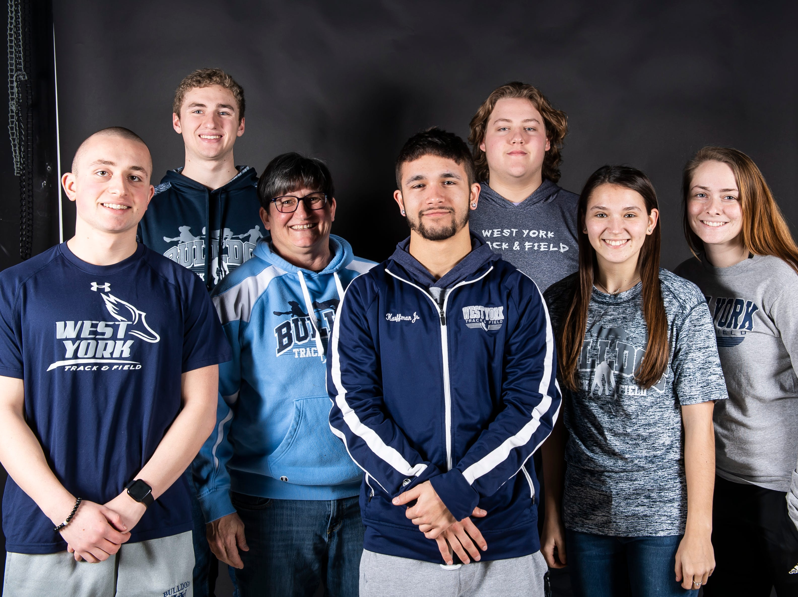 (From left) West York track and field athletes Kieran McKee, Jacob Franklin, coach Julie Haynes, Shane Kauffman, Jacoby Snyder, Emily Sweitzer and Claudia Gross pose in the GameTimePA photo booth during spring sports media day in York Sunday, March 10, 2019.