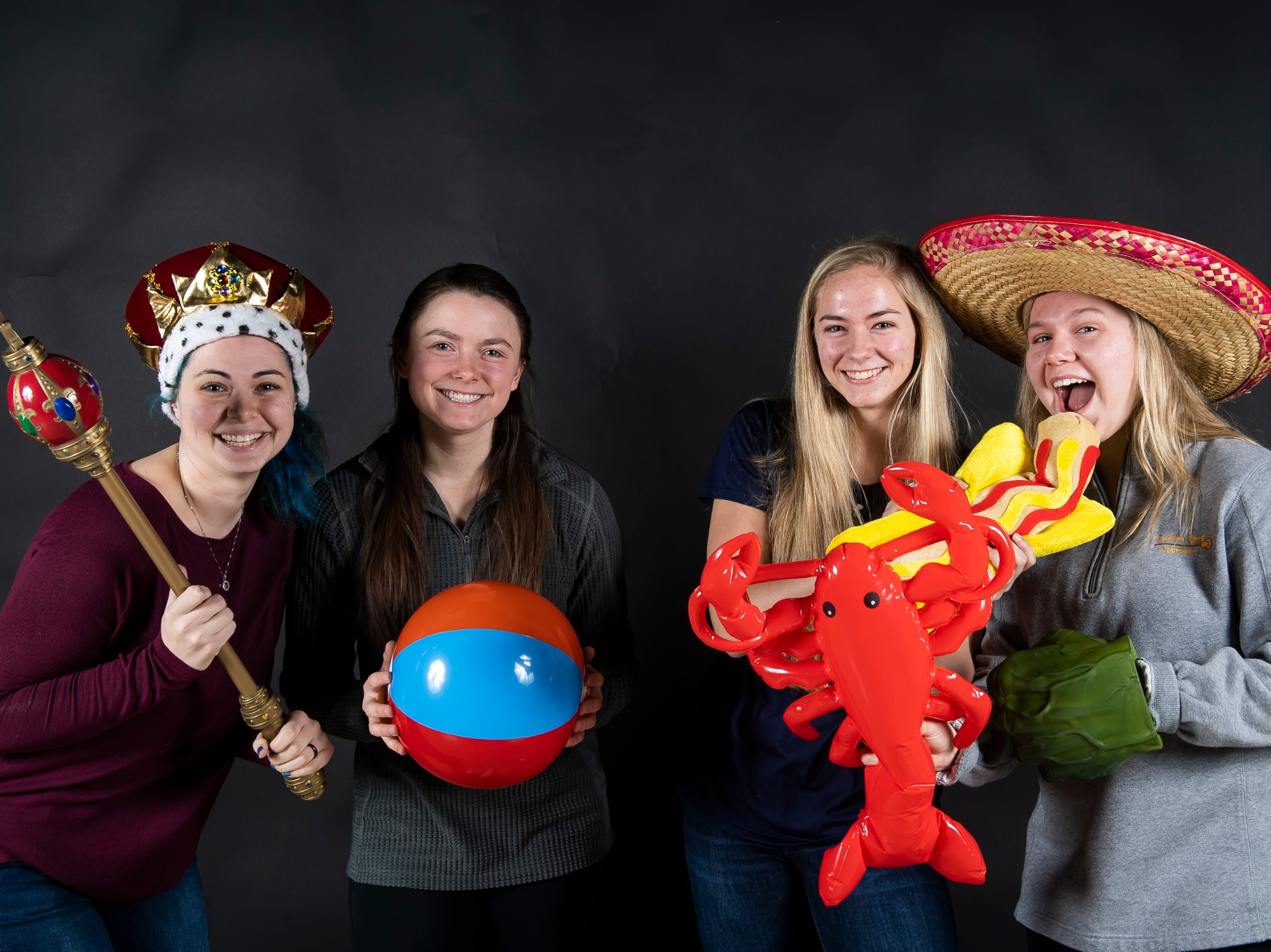 The Eastern York girls lacrosse team strike a pose with in the GameTimePA photo booth during spring sports media day in York Sunday, March 10, 2019.