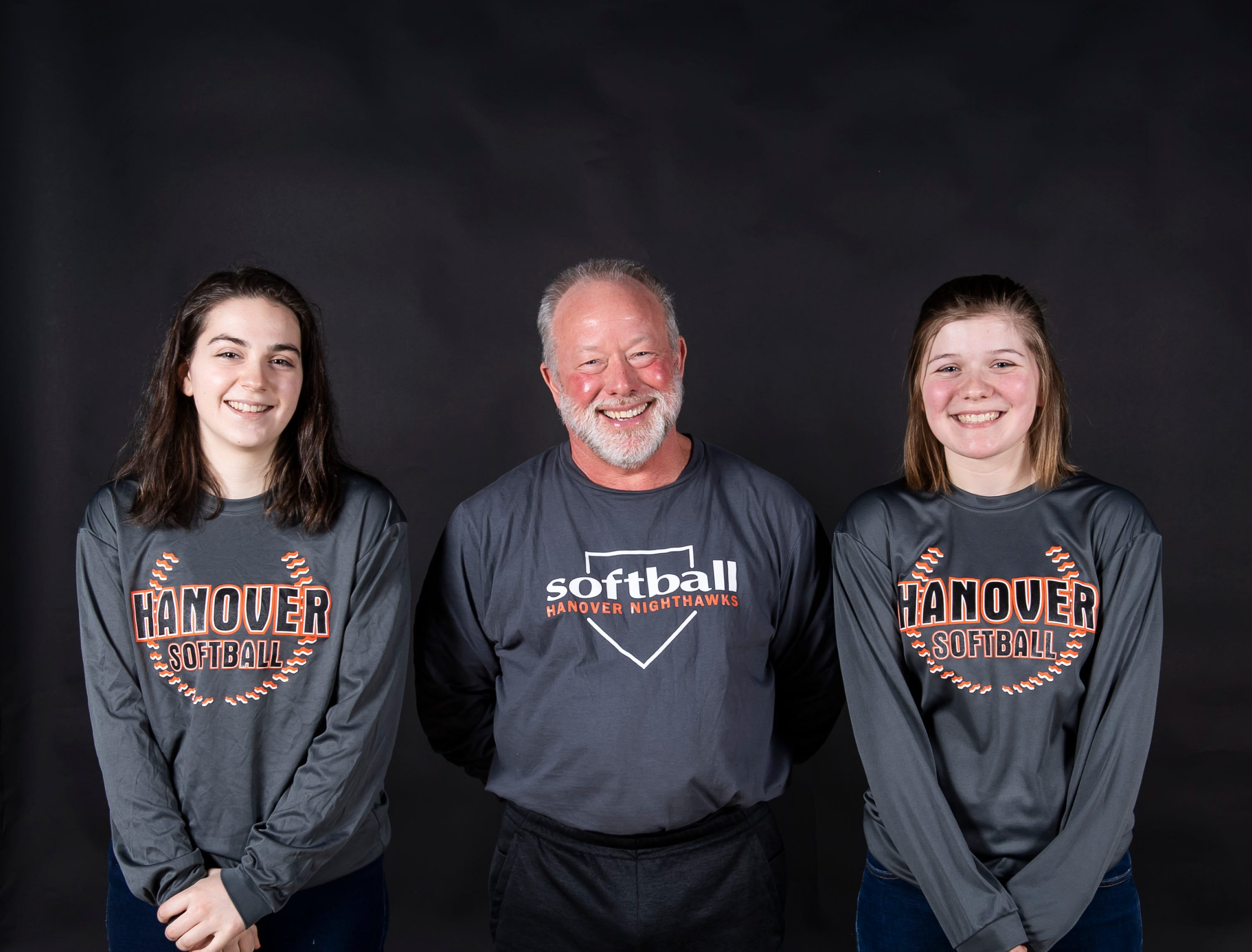(From left) Hanover softball's Emily Hann, coach Henry Wardrop and Sierra Stevens pose in the GameTimePA photo booth during spring sports media day in York Sunday, March 10, 2019.