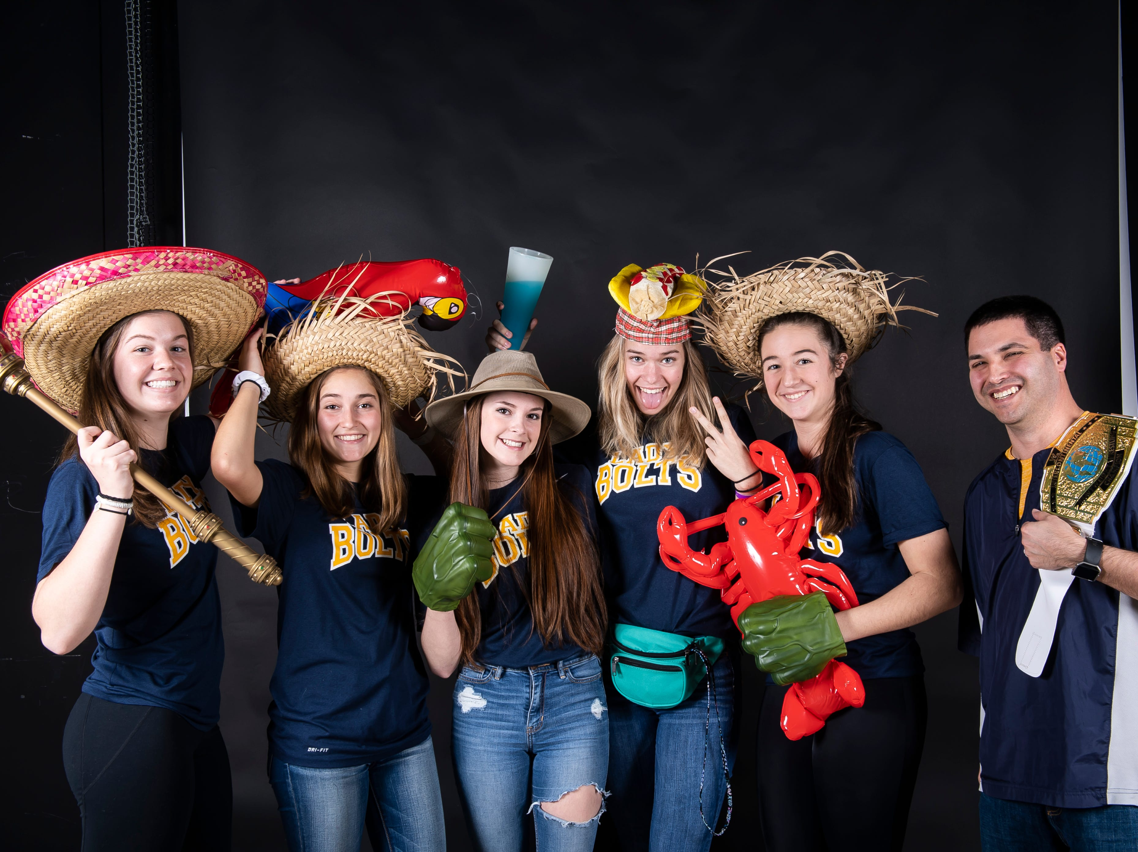(From left) Littlestown softball players Kacie Frock, Carter Clabaugh, Jada Mummert, Caitlin Eader and Amaya Bowman strike a pose with coach Jeff Laux in the GameTimePA photo booth during spring sports media day in York Sunday, March 10, 2019.