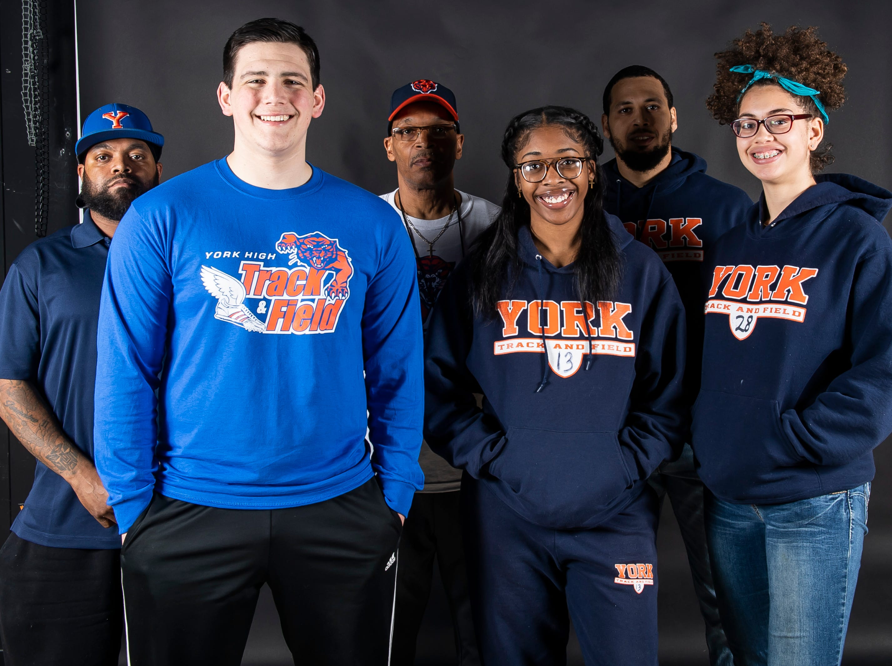 (From back left) York High track and field's coach Jermaine Bailey, coach Tony Jones, coach Andrew Lehigh, Trey Bernstein, Victoria Jean-Baptiste and Janelle Soussa pose in the GameTimePA photo booth during spring sports media day in York Sunday, March 10, 2019.