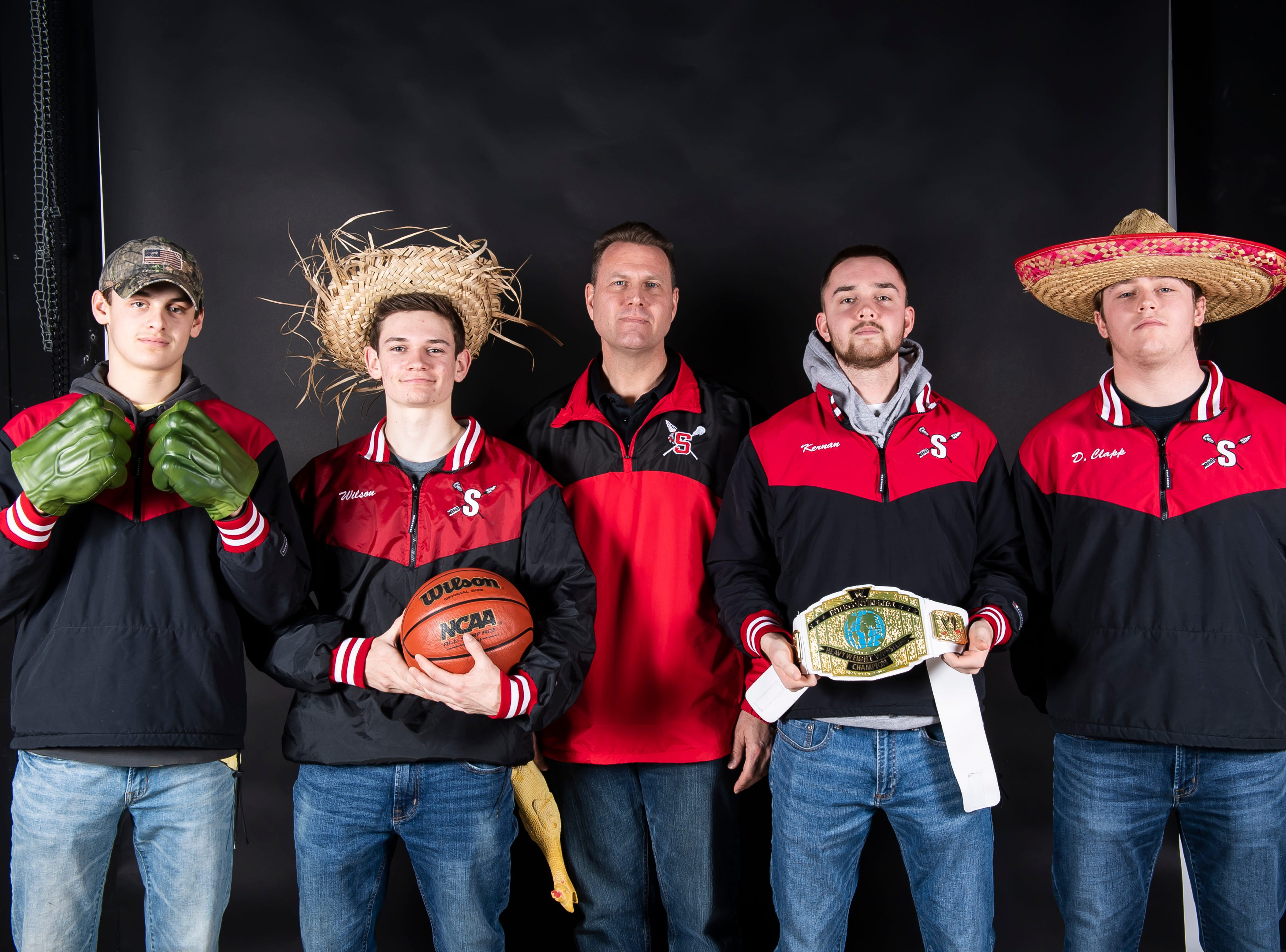 The Susquehannock boys lacrosse team strike a pose in the GameTimePA photo booth during spring sports media day in York Sunday, March 10, 2019.