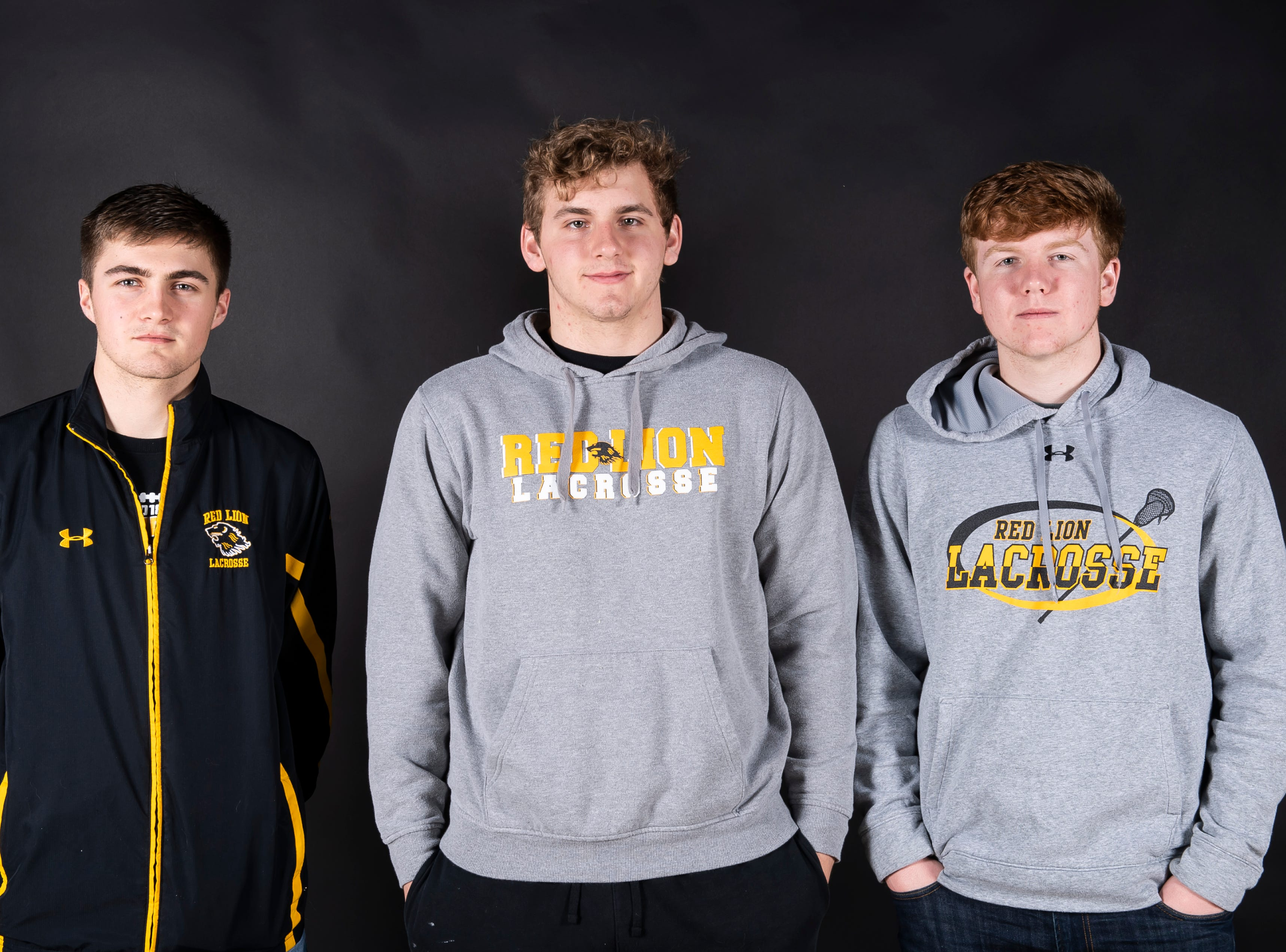 (From left) Red Lion lacrosse players Ben Hornberger, Eli Workinger and Quinn Lyons pose in the GameTimePA photo booth during spring sports media day in York Sunday, March 10, 2019.