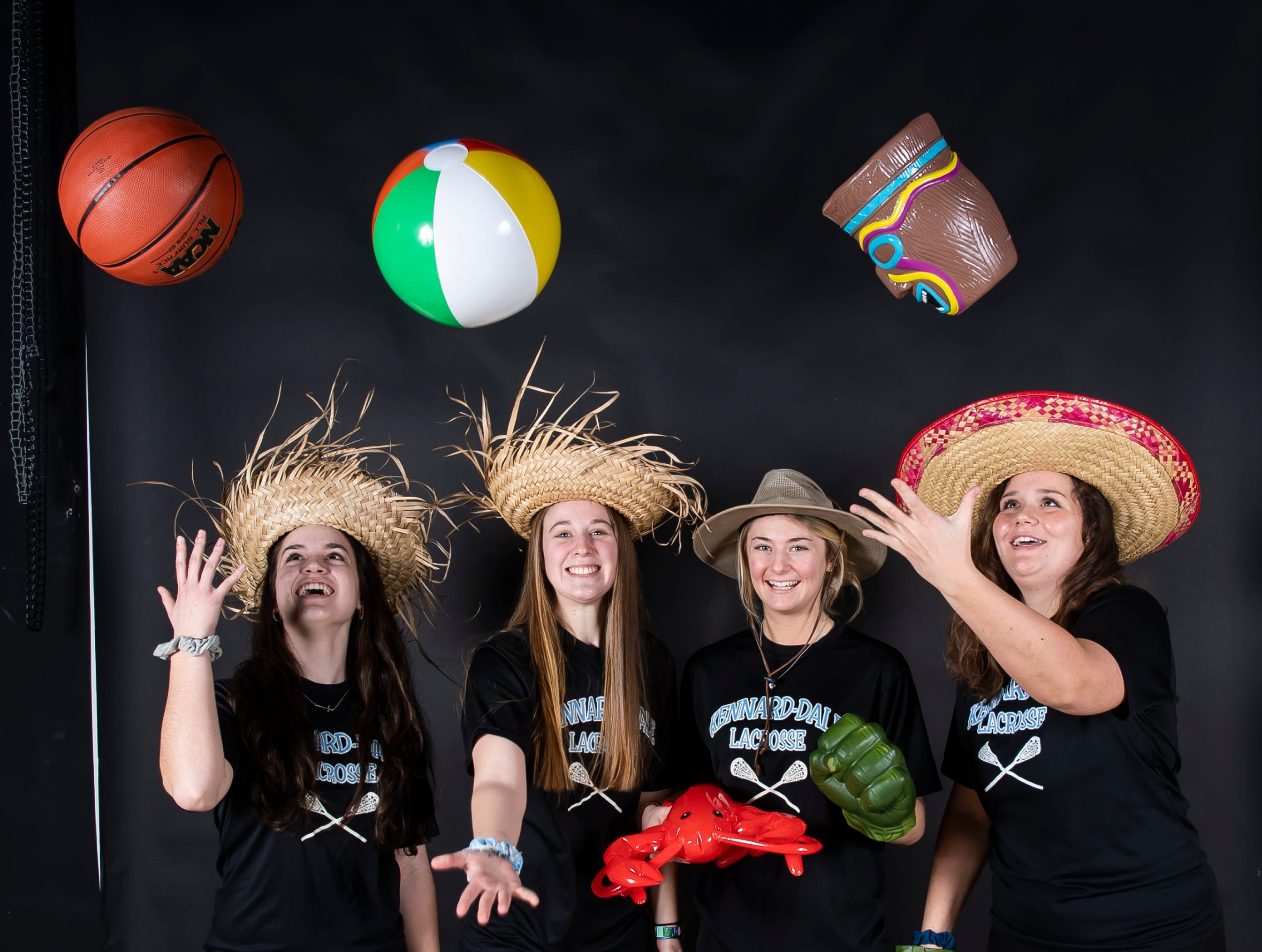 (From left) Kennard-Dale lacrosse players Maria Schneider, Mackenzie Young, Megan Halczuk and Lily Dressle strike a pose in the GameTimePA photo booth during spring sports media day in York Sunday, March 10, 2019.