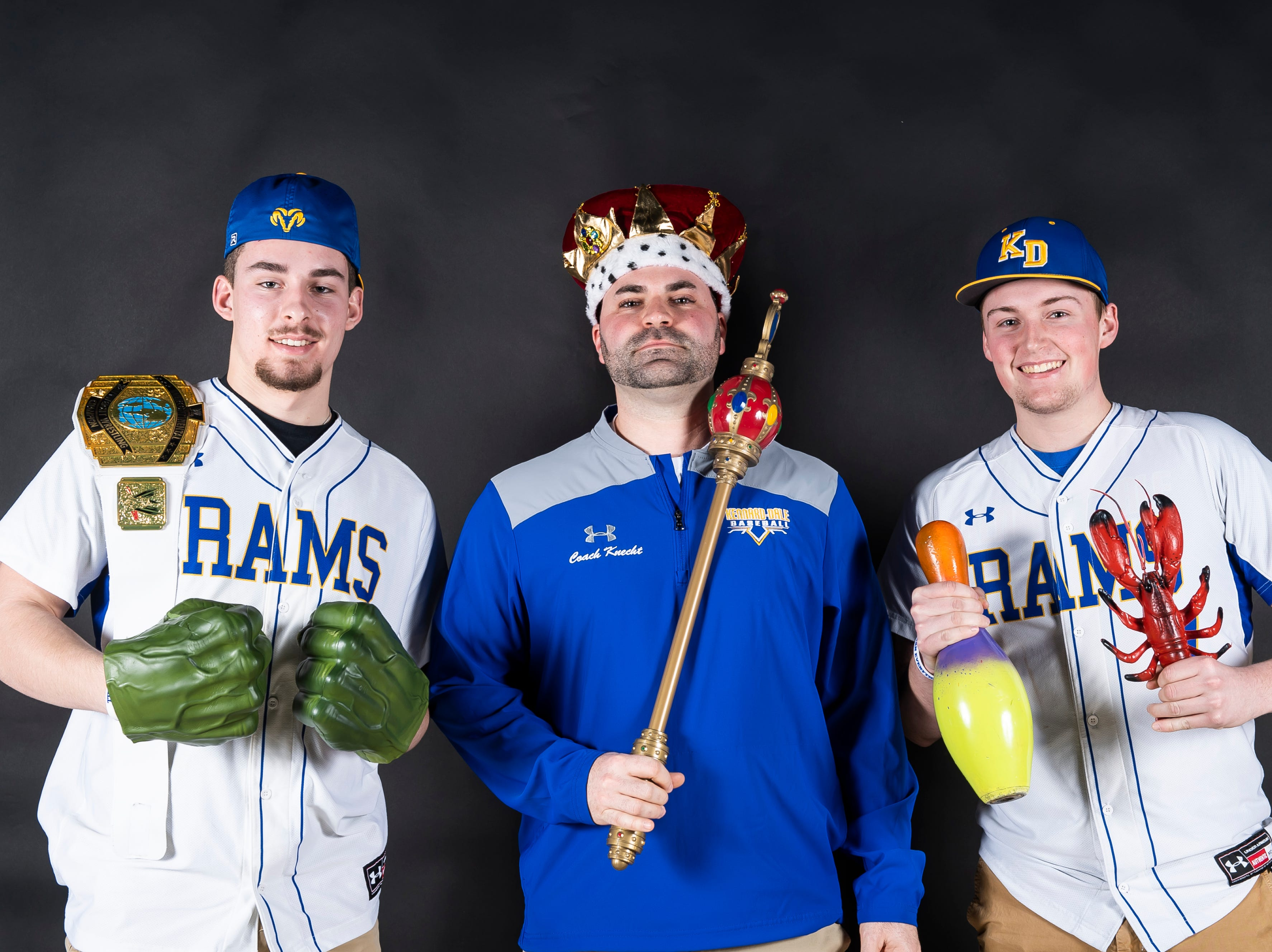 (From left) Kennard-Dale baseball's Garrett Lowe, coach Blake Knecht and Cole Sinnott strike a pose in the GameTimePA photo booth during spring sports media day in York Sunday, March 10, 2019.