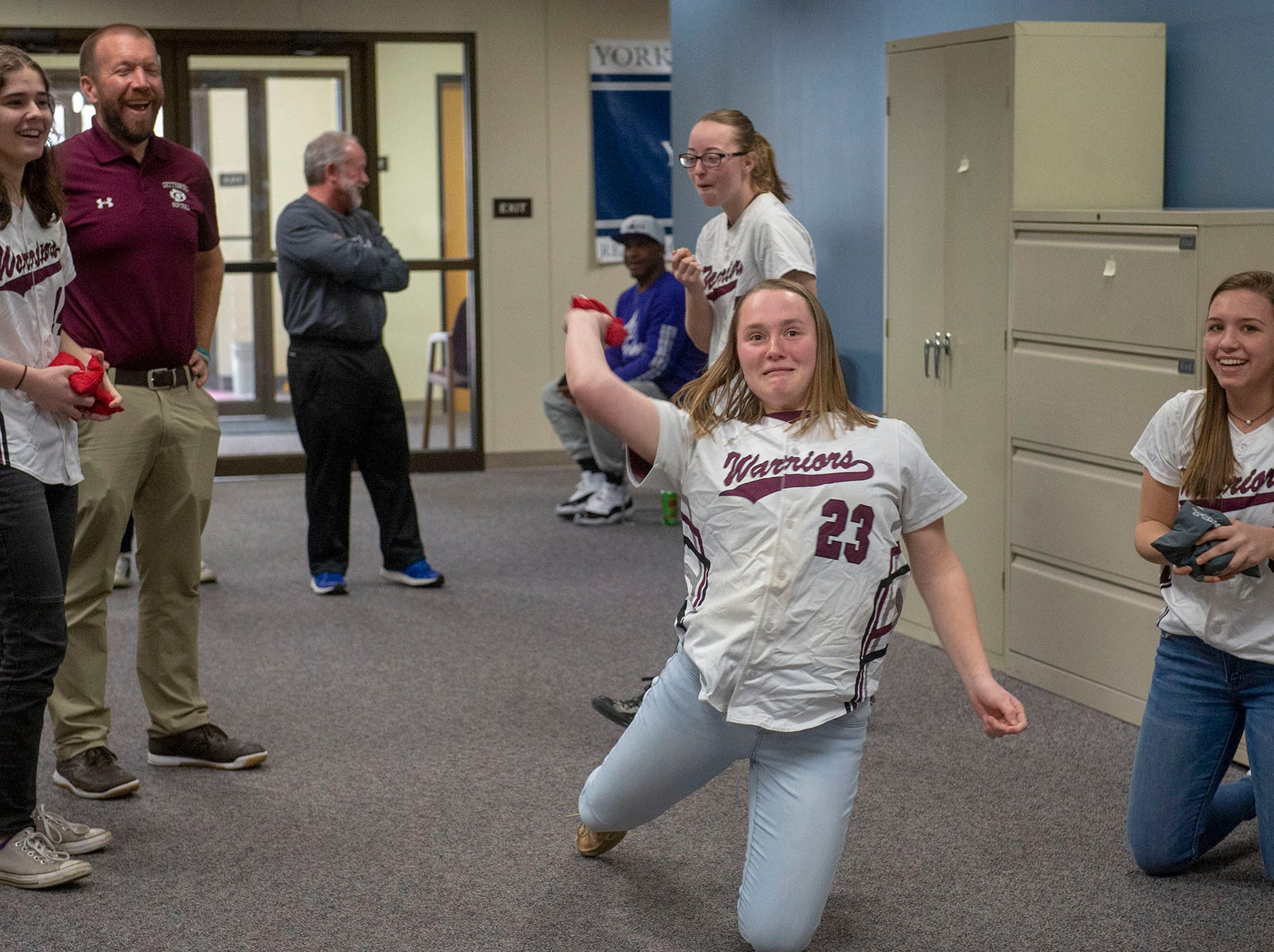 Gettysburg softball player Rachel Keller tried throwing from her catcher's position in the long-distance cornhole throw at GameTimePA's YAIAA Spring Media Day on Sunday, March 10, 2019.
