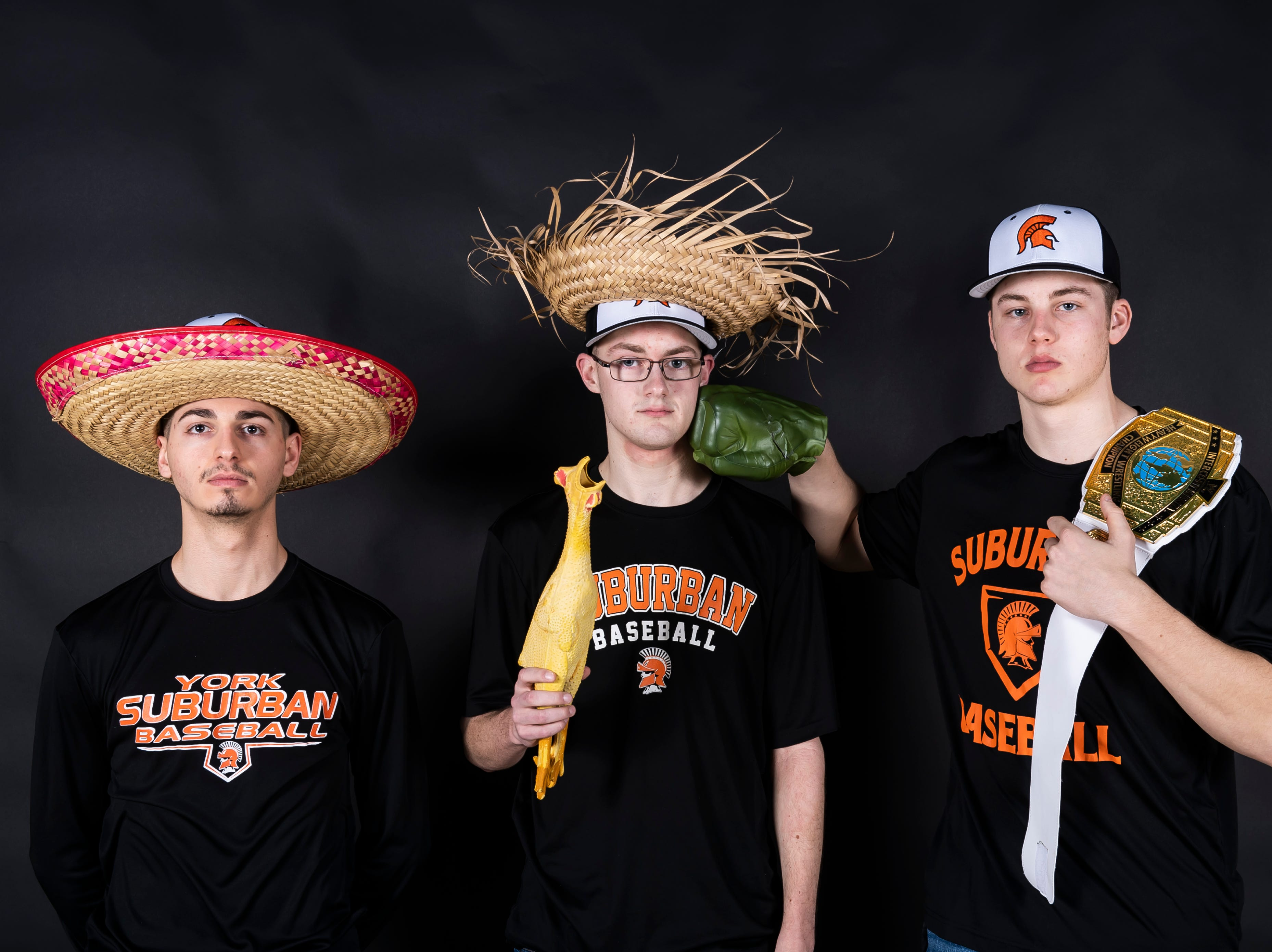 (From left) York Suburban baseball's Adam Petersen, Ryan Myers and Max Reinecker pose in the GameTimePA photo booth during spring sports media day in York Sunday, March 10, 2019.