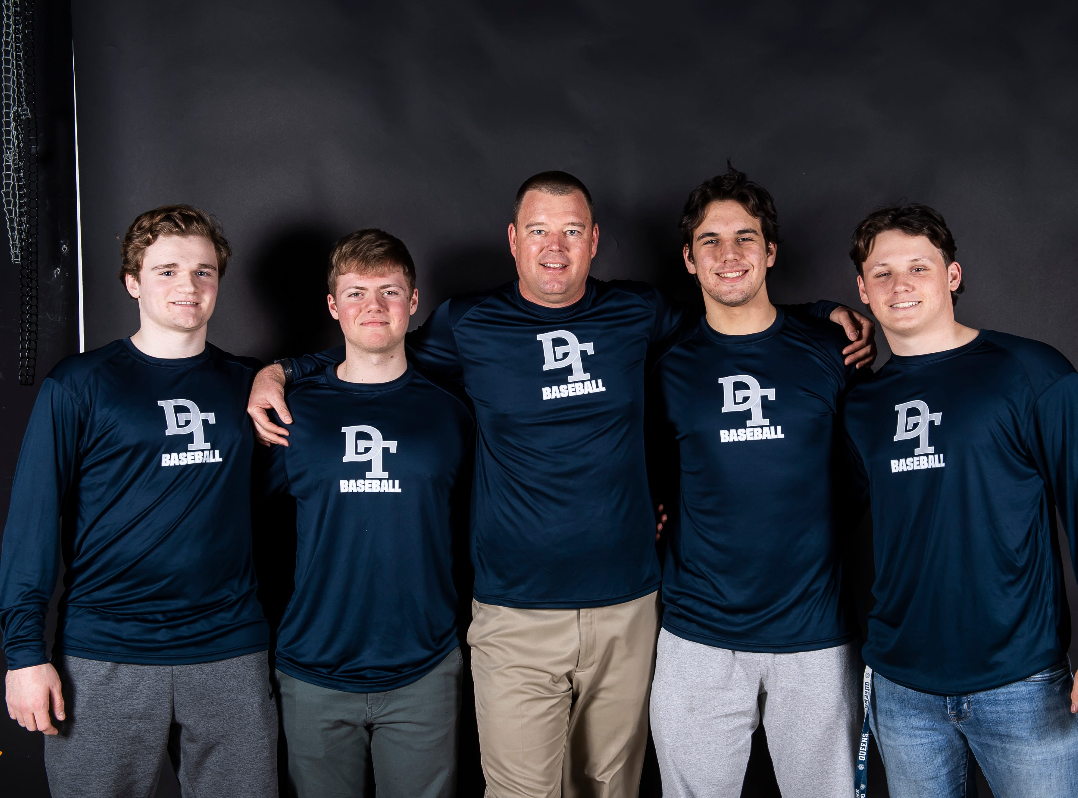 (From left) Dallastown baseball's Chase Hoecke, Alex Weakland, coach Greg Kinneman, Peter Capobianco and Julian Bailey pose in the GameTimePA photo booth during spring sports media day in York Sunday, March 10, 2019.