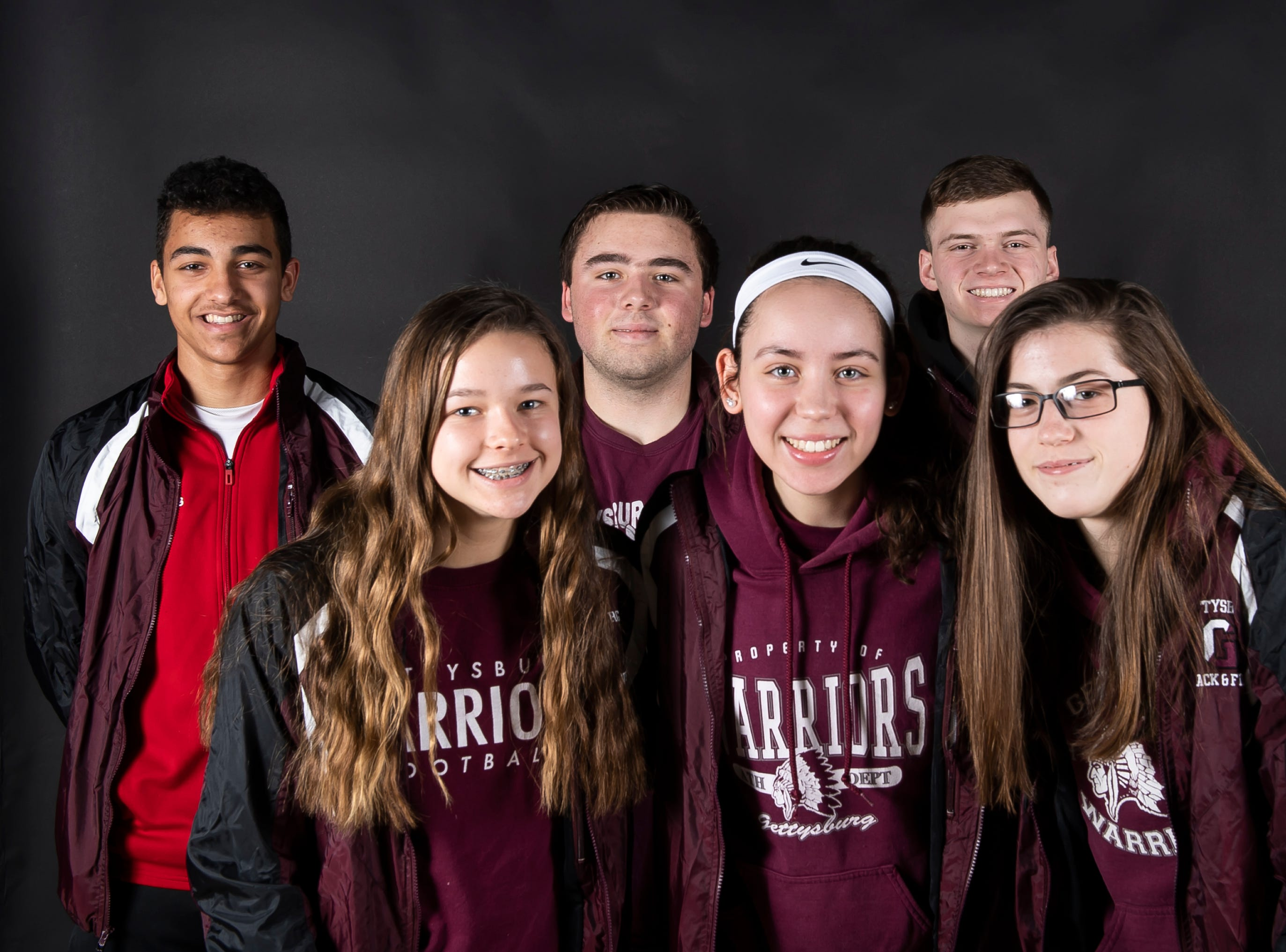 (From back left) Gettysburg track and field athletes Noah Sanders, Cory Bixler, Andrew Hirneisen, Lora Bertram, Sidney Shelton and Kelty Oaster pose in the GameTimePA photo booth during spring sports media day in York Sunday, March 10, 2019.