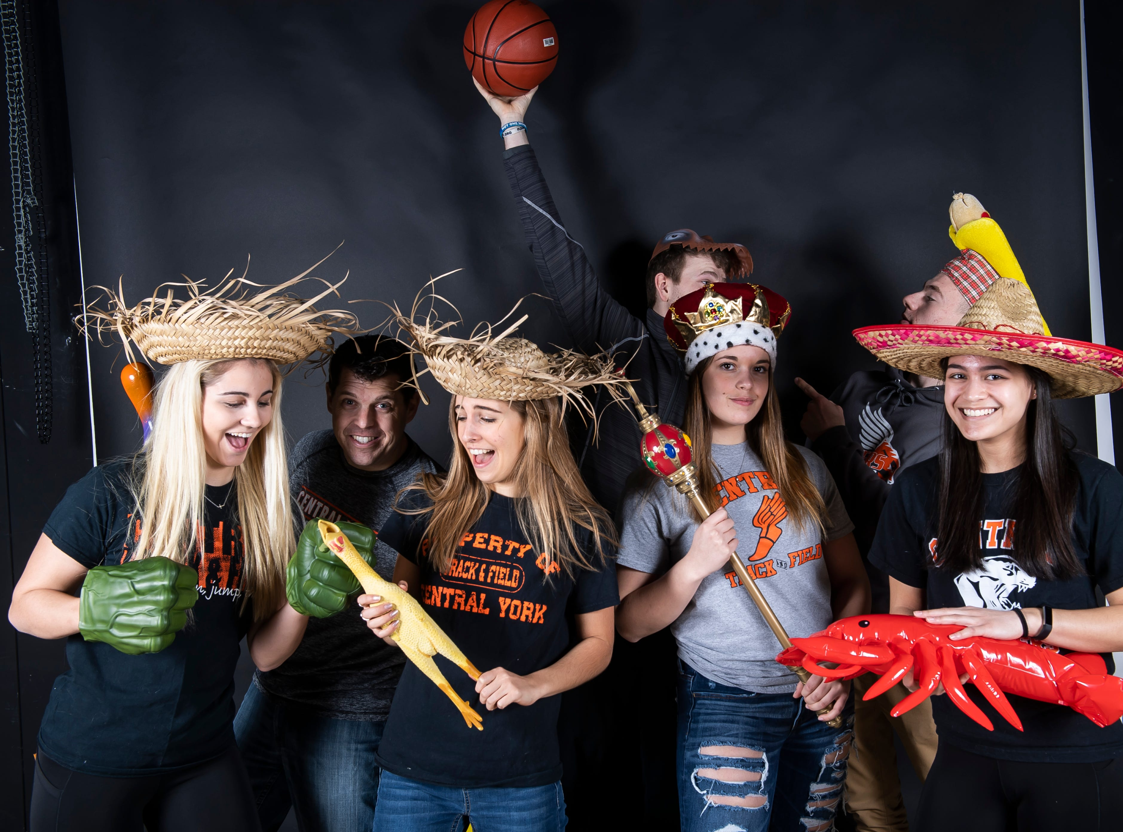 The Central York track and field team strike a pose in the GameTimePA photo booth during spring sports media day in York Sunday, March 10, 2019.