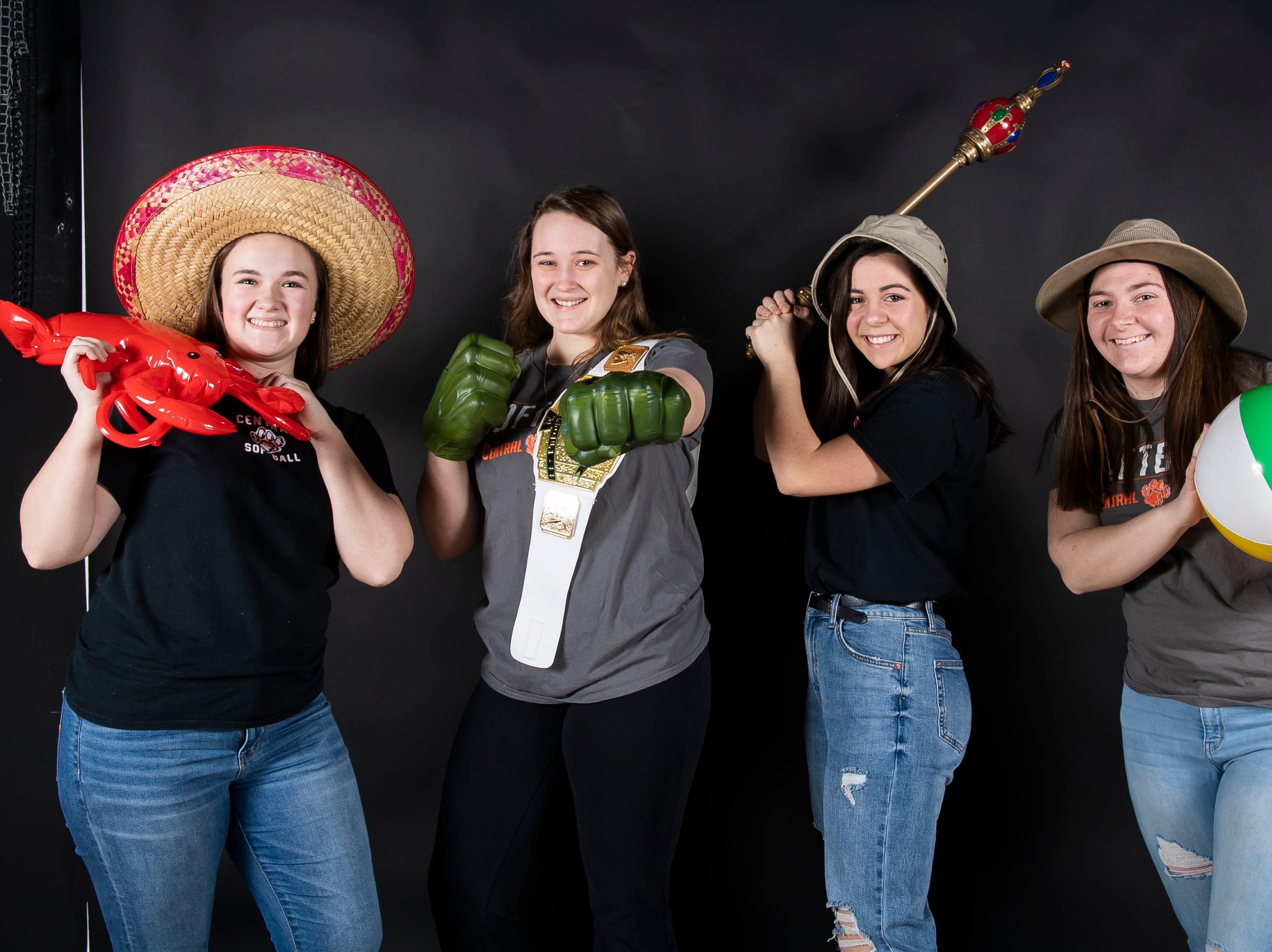 (From left) Central York softball's Sarah White, Natalie Craig, Grace Smith and Brianna Smith strike a pose in the GameTimePA photo booth during spring sports media day in York Sunday, March 10, 2019.