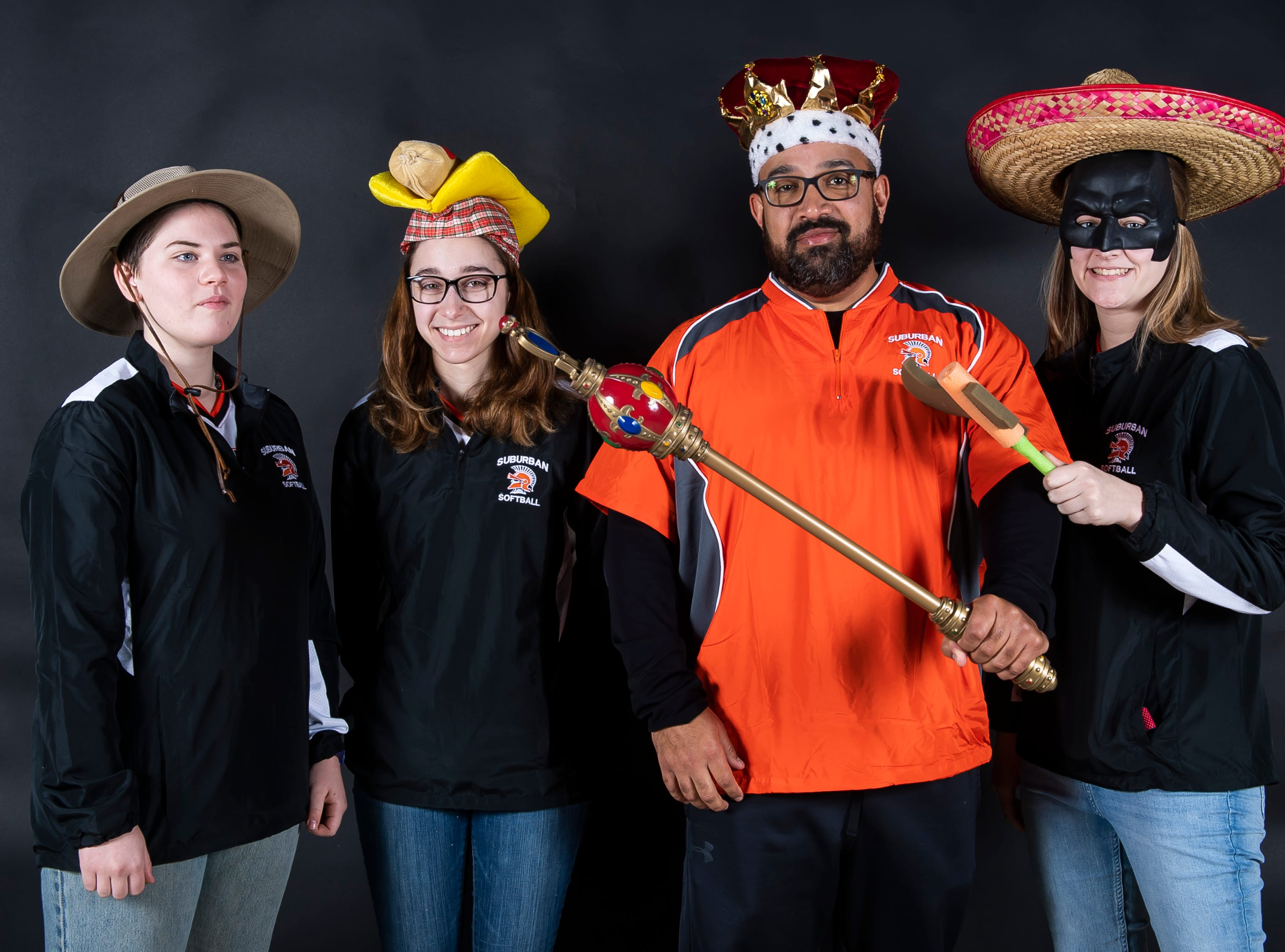 The York Suburban softball team pose with coach Larry Dalton in the GameTimePA photo booth during spring sports media day in York Sunday, March 10, 2019.