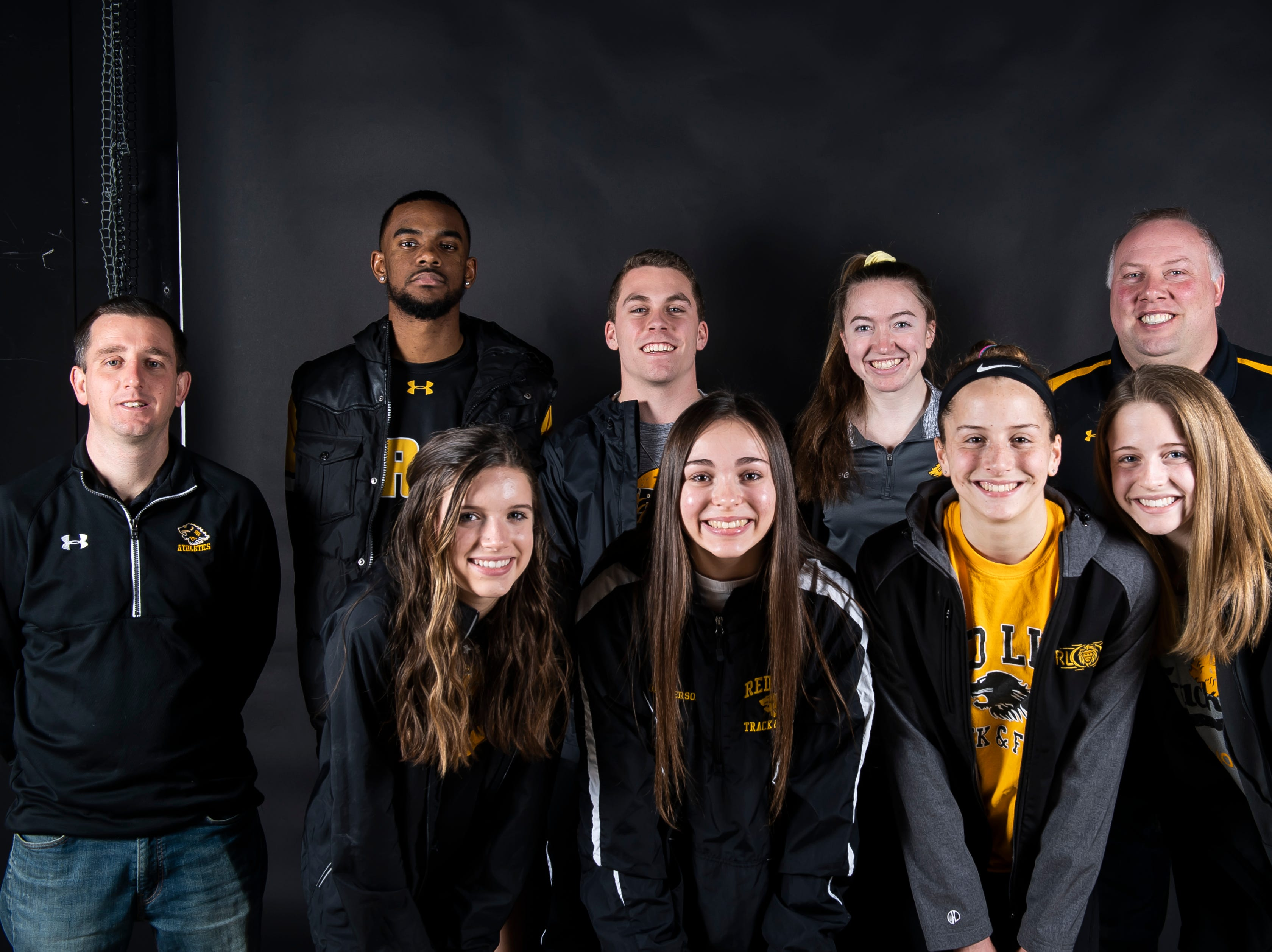 (From back left) Red Lion track and field's coach Todd Barshinger, Phill Douglass, Mitch Held, Kaylee Snyder, coach Jason Smith, Lily Hare, Sydney Beaverson, Kiersten Lloyd and Gwen Lloyd pose in the GameTimePA photo booth during spring sports media day in York Sunday, March 10, 2019.