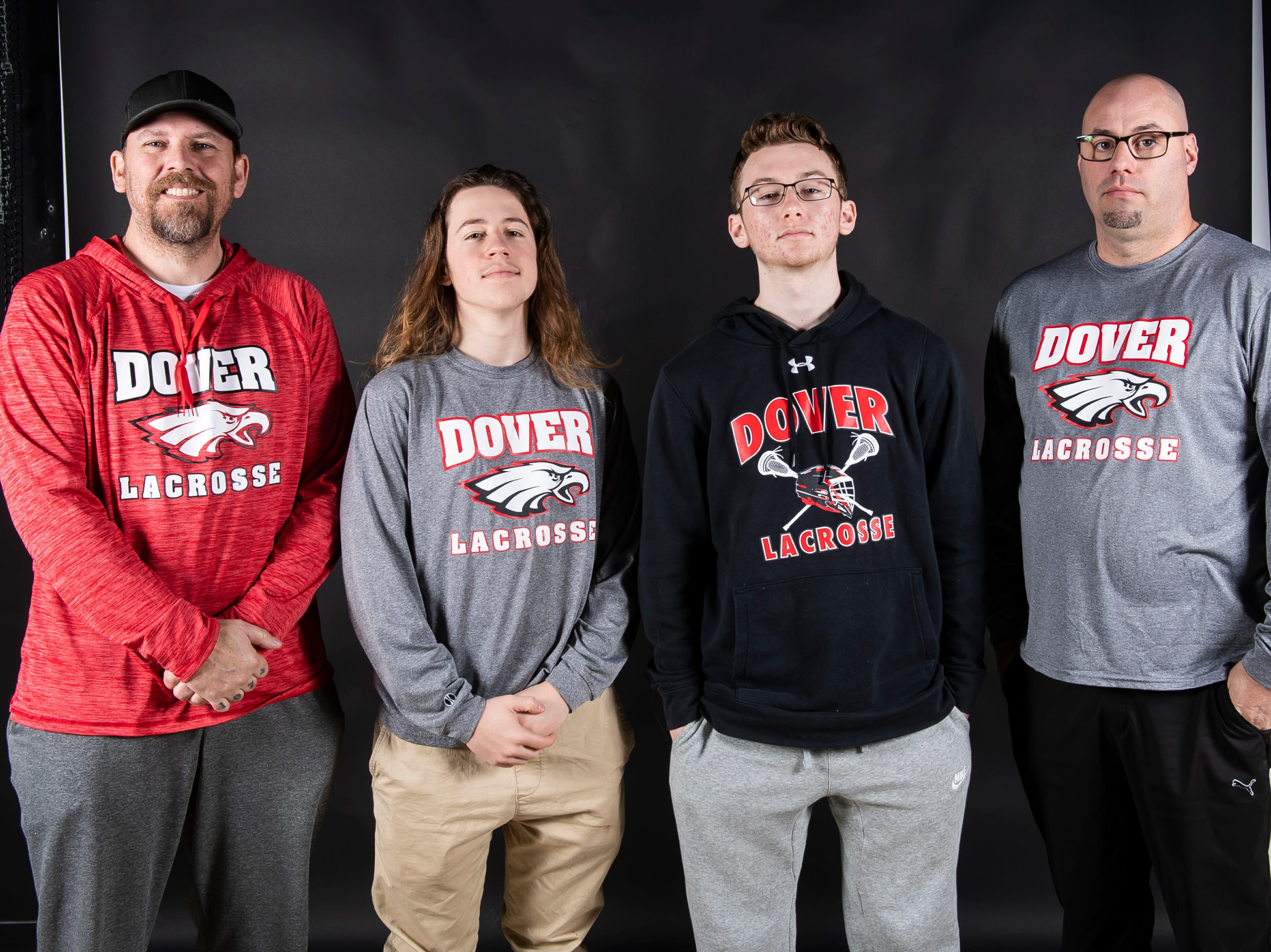 (From left) Dover boys lacrosse's coach Brian Chamberlain Sr., Cole Brickley, Brian Chamberlain and coach Bob Boyer pose in the GameTimePA photo booth during spring sports media day in York Sunday, March 10, 2019.